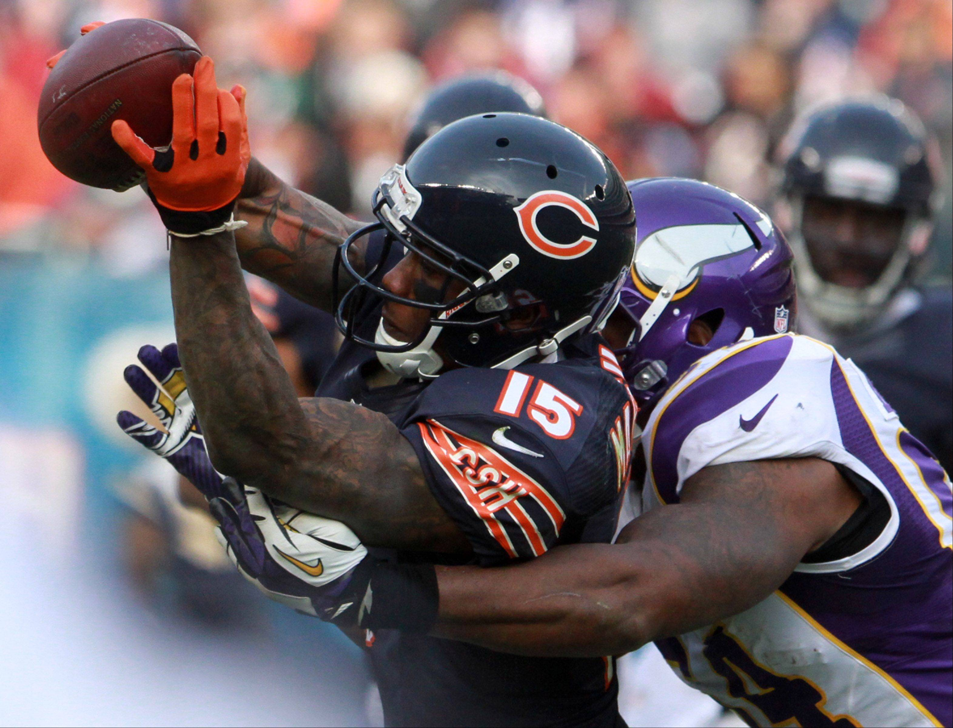 Chicago Bears Brandon Marshall pulls in a pass against Minnesota Vikings' Jasper Brinkley at Soldier Field Sunday