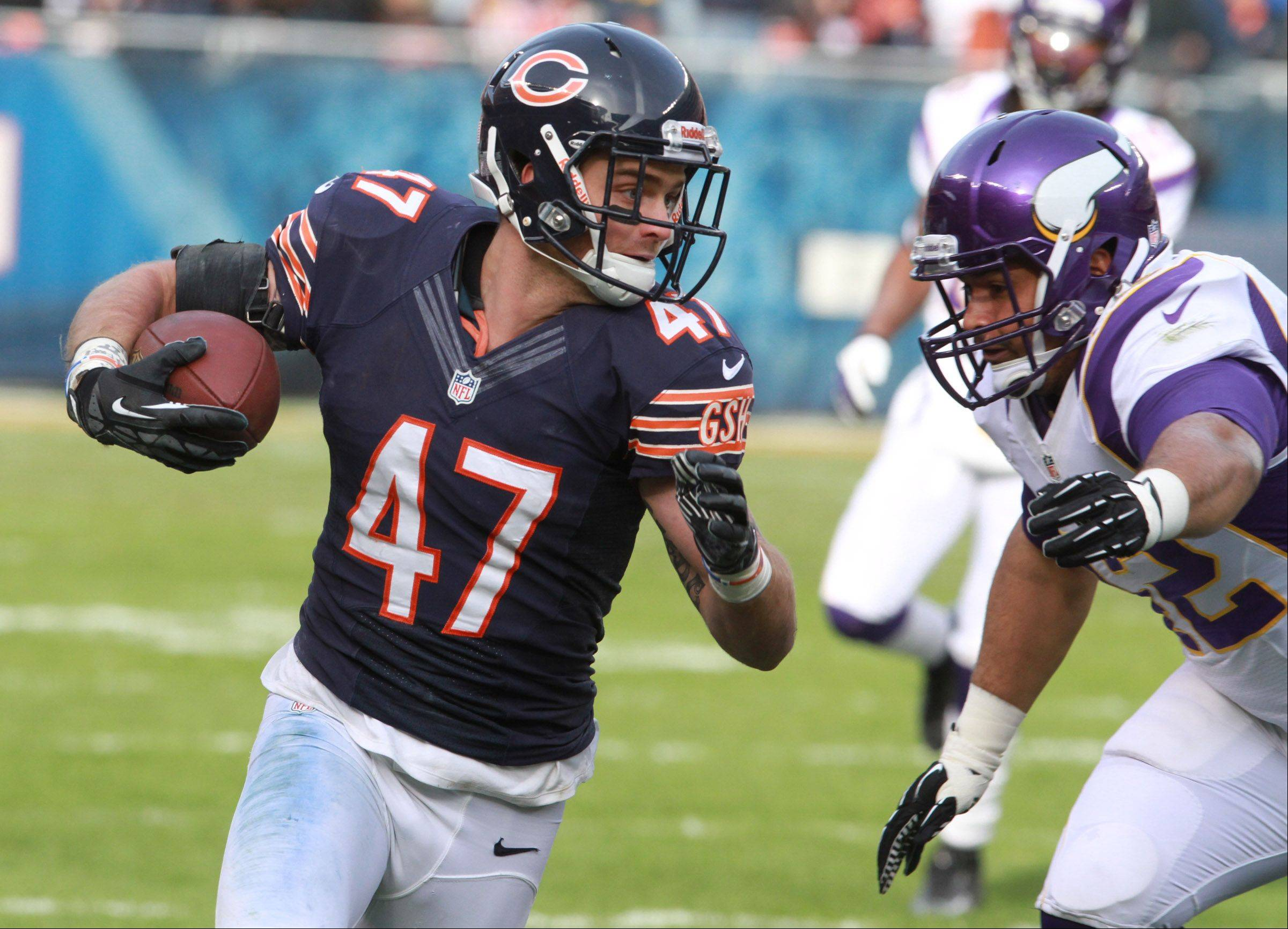 Chicago Bears free safety Chris Conte runs past Minnesota Vikings fullback Jerome Felton after intercepting a pass at Soldier Field Sunday.