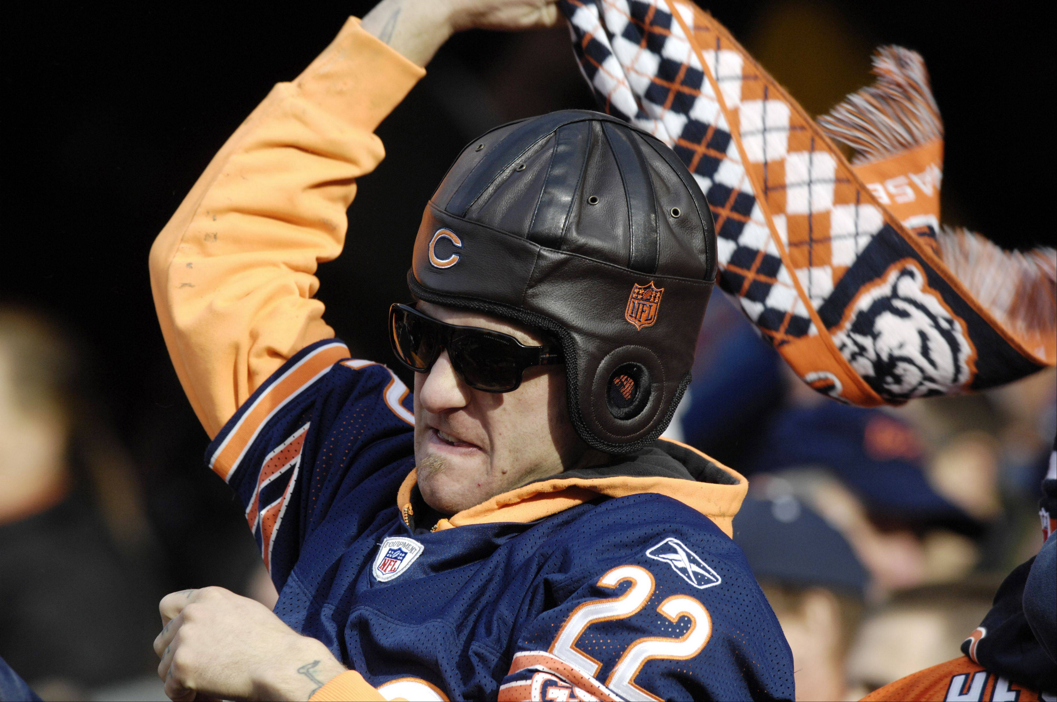 A Bears fan celebrates after a Minnesota Vikings touchdown was called back in favor of the Bears at Soldier Field Sunday.