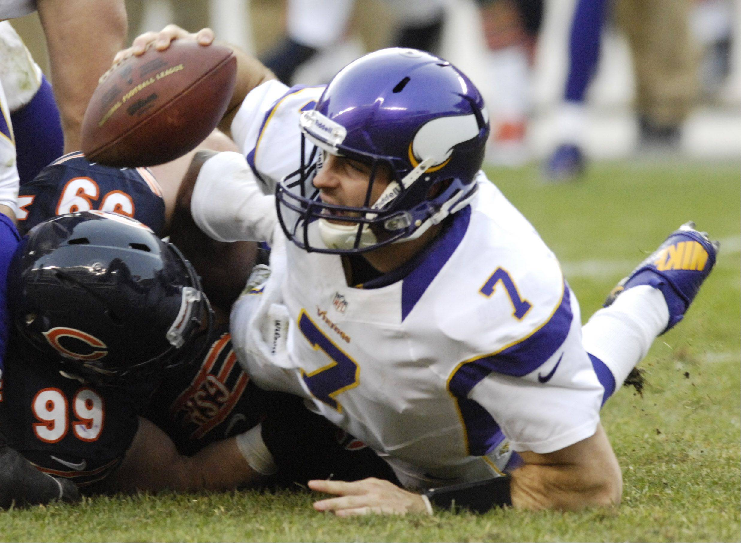 Minnesota Vikings quarterback Christian Ponder gets sacked by Chicago Bears defensive end Shea McClellin at Soldier Field Sunday.