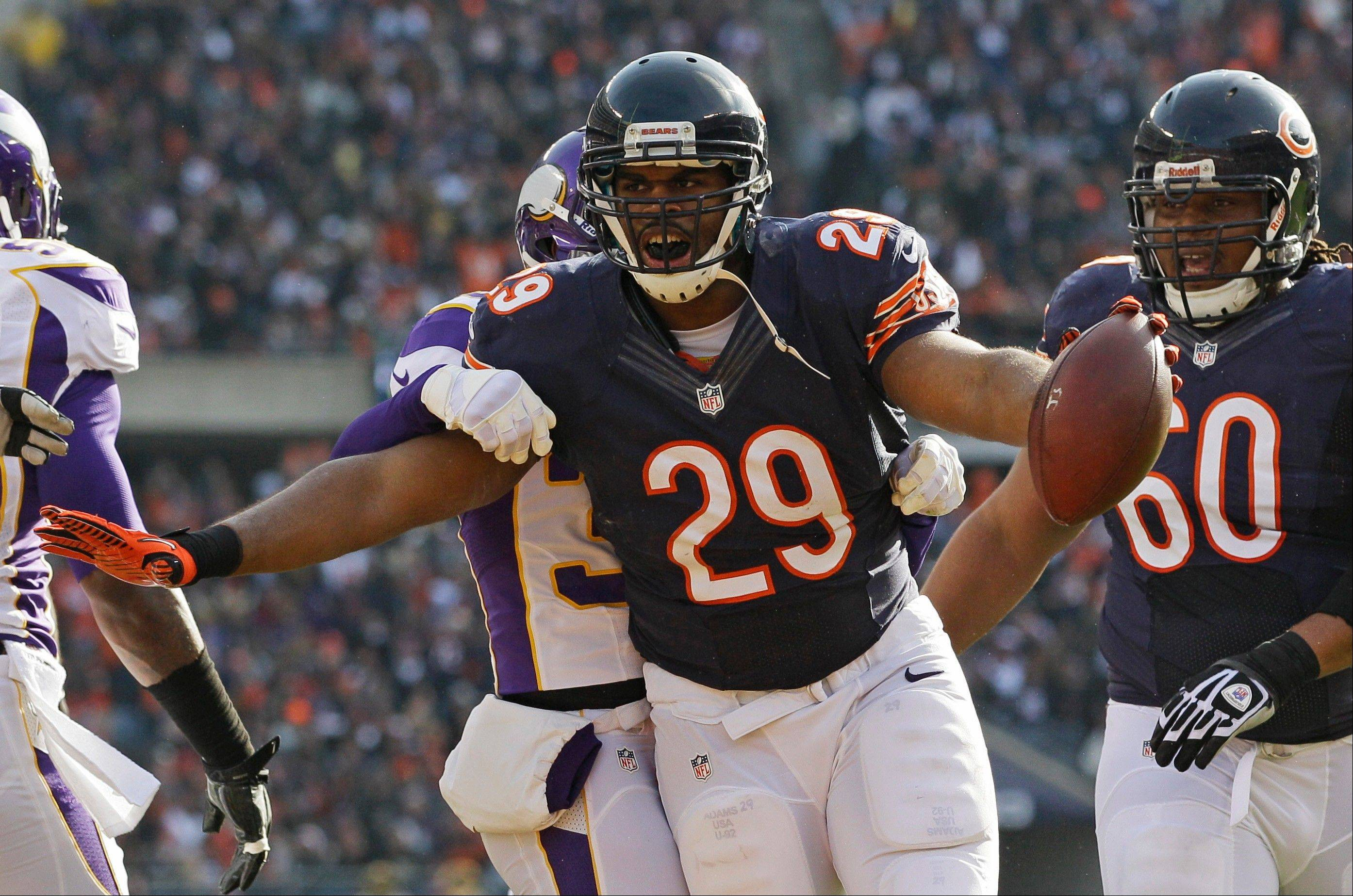 Chicago Bears running back Michael Bush (29) celebrates his touchdown run in the first half of an NFL football game against the Minnesota Vikings in Chicago, Sunday.