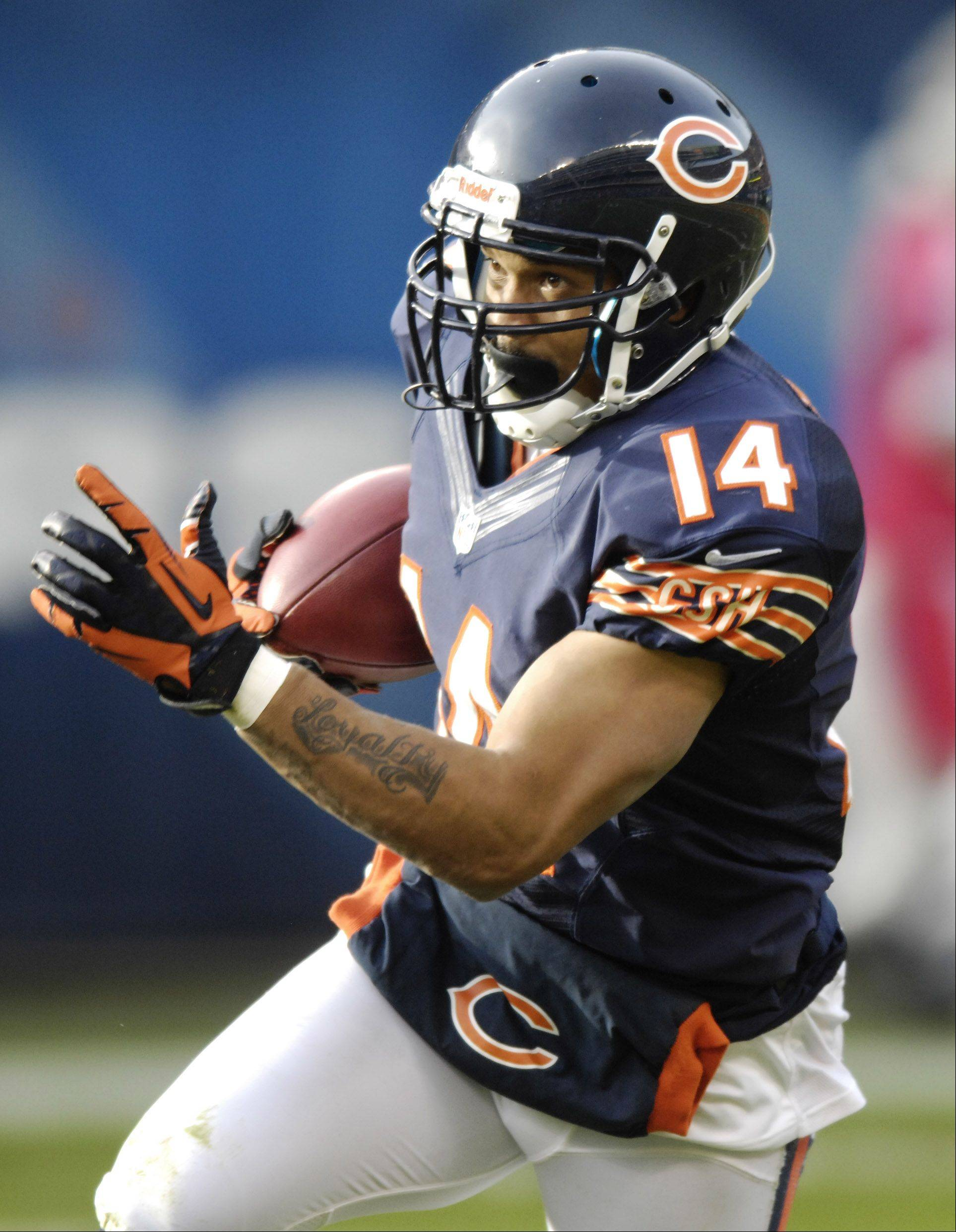 Eric Weems of the Bears returns a kickoff against the Vikings at Soldier Field Sunday.