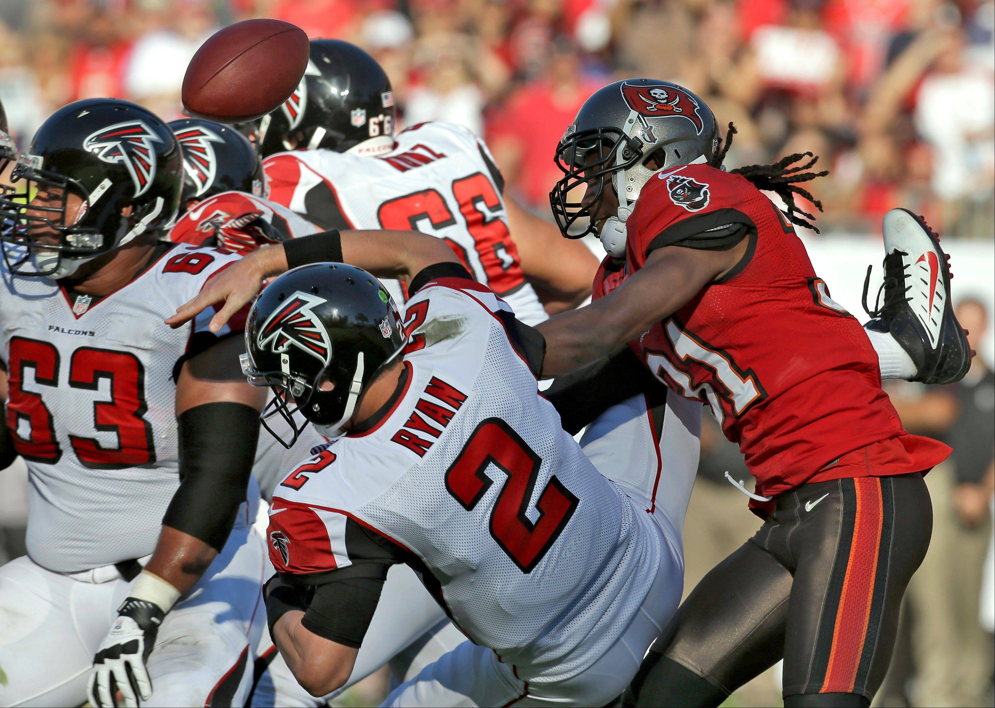 Tampa Bay Buccaneers cornerback E.J. Biggers hits Atlanta Falcons quarterback Matt Ryan, forcing a fumble during the fourth quarter of Sunday's game in Tampa, Fla.