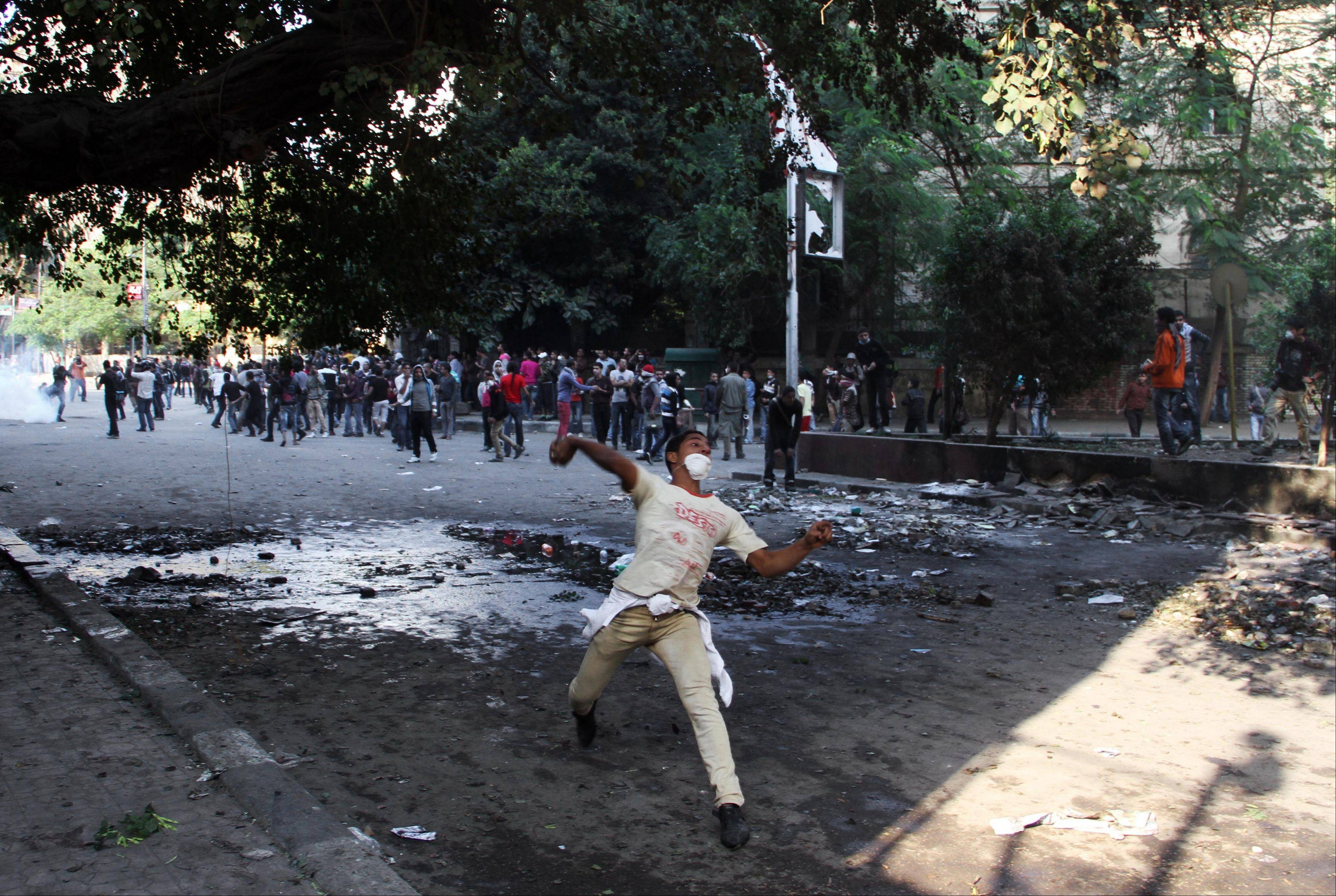 Egyptian protesters clash with security forces near Tahrir Square in Cairo, Egypt, Sunday.