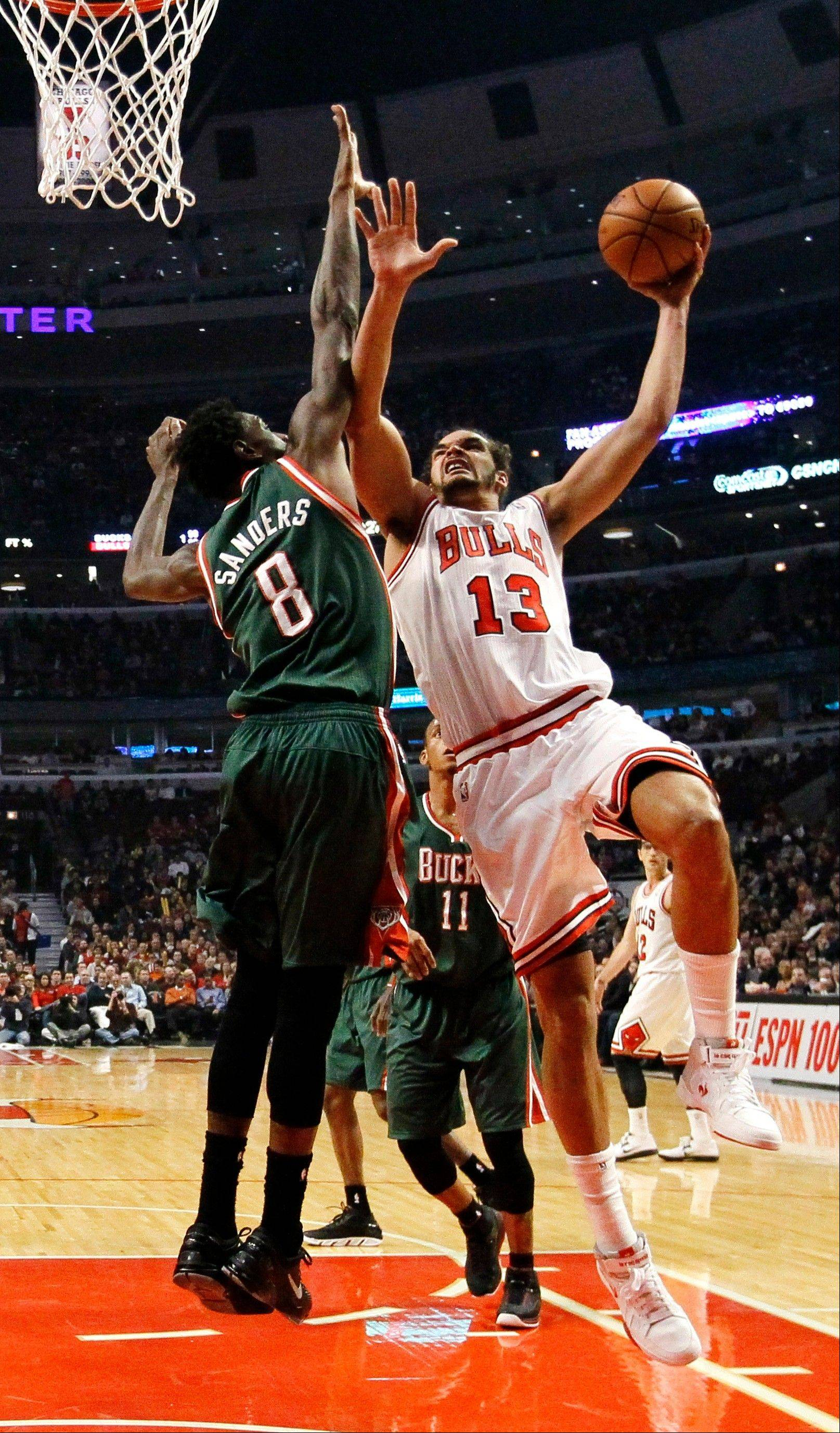 The Bulls� Joakim Noah shoots over Bucks center Larry Sanders in the first half Monday at the United Center. The Bucks rallied from a big deficit to win 93-92.