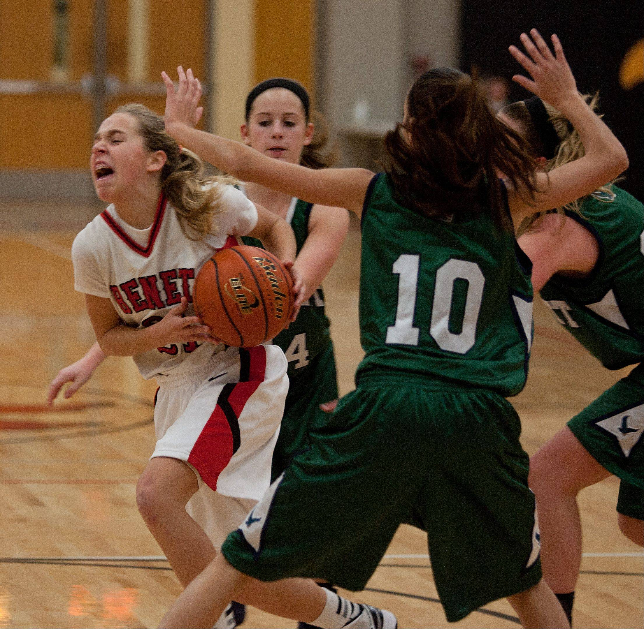 Benet�s Kathleen Doyle, left, drives past Bartlett�s Nicole Gerdevich, during girls basketball action at Benet.