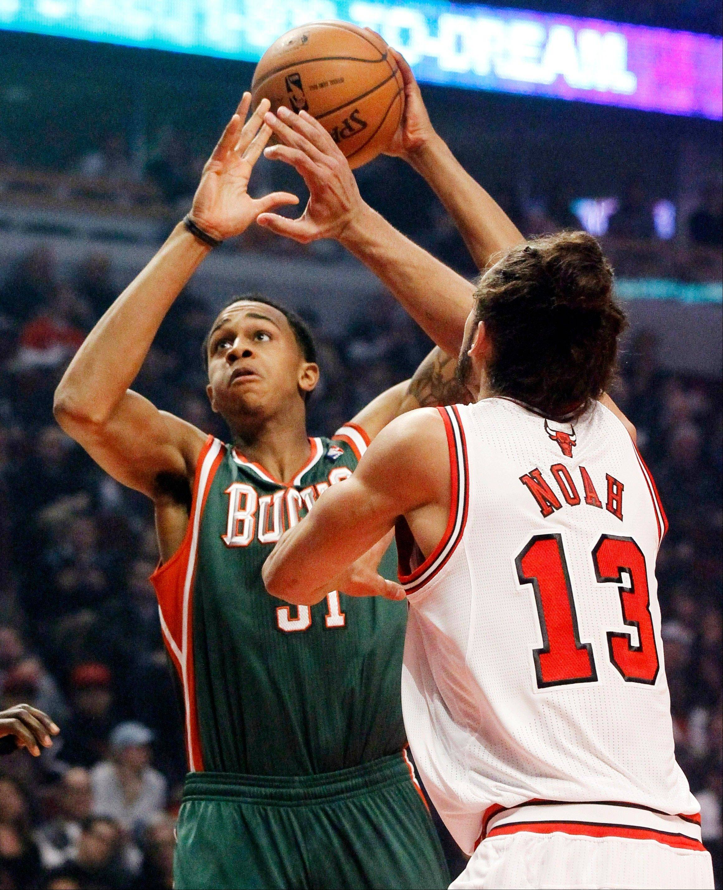 Milwaukee Bucks forward John Henson (31) shoots over Chicago Bulls center Joakim Noah (13) during the first half of an NBA basketball game, Monday, Nov. 26, 2012, in Chicago.