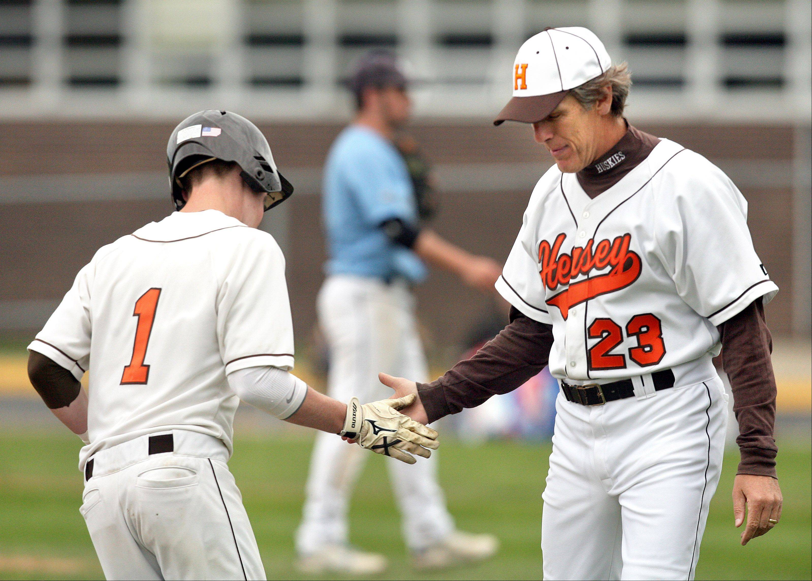 STEVE LUNDY/slundy@dailyherald.com Hersey baseball coach Bob Huber, right, is headed for the Illinois Baseball Coaches Hall of Fame.