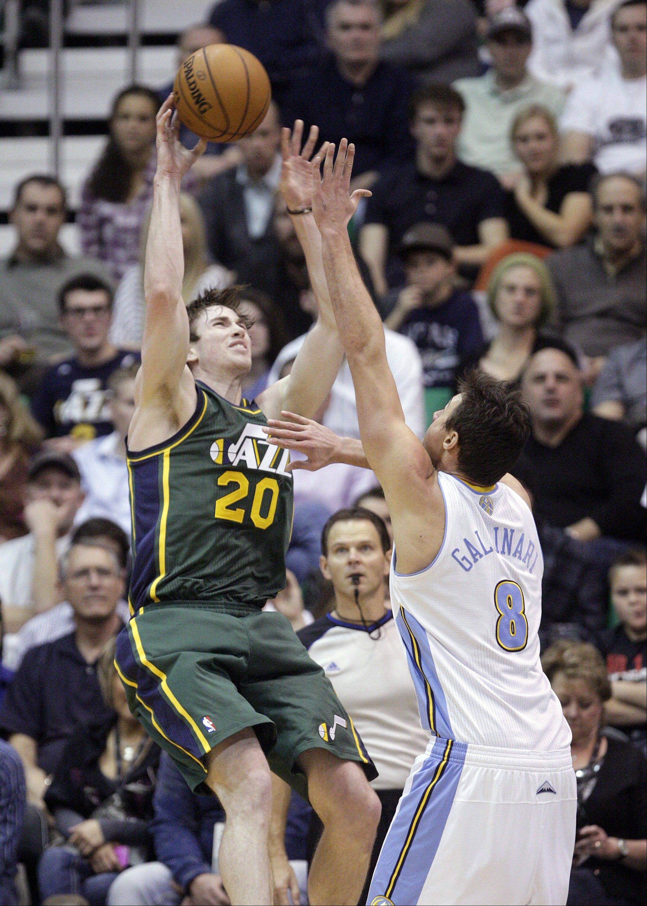 Utah Jazz guard Gordon Hayward (20) shoots as Denver Nuggets forward Danilo Gallinari (8) defends in the second quarter during an NBA basketball game Monday, Nov. 26, 2012, in Salt Lake City.