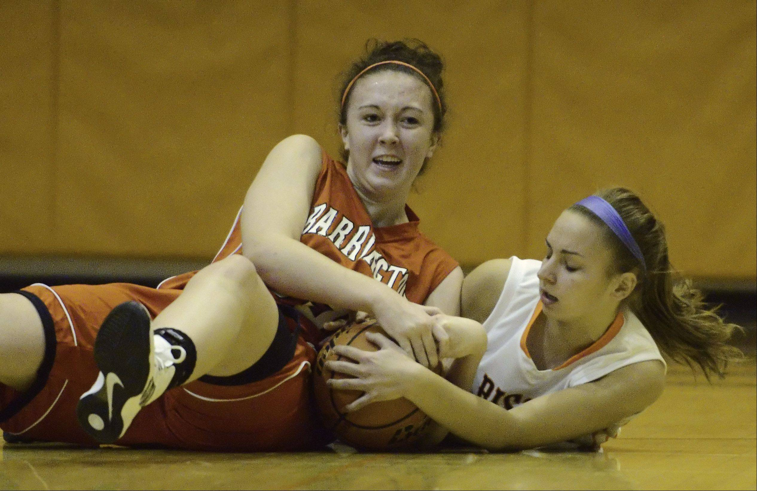 Barrington's Aoife Callanan, left, and Buffalo Grove's Amanda Salzman dive to the floor while trying to gain possession of a loose ball during Friday's game.