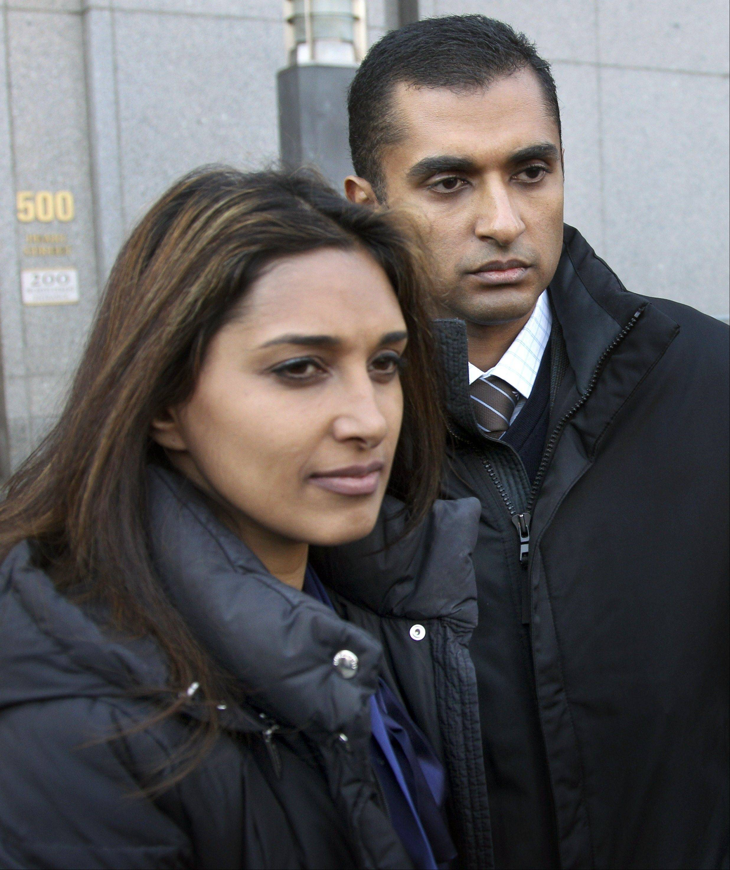 Mathew Martoma, right, leaves the federal courthouse with his wife, Rosemary, in New York Monday. Martoma, accused of enabling a quarter of a billion dollars in profits through inside information, appeared in a New York court Monday for the first time and was released on $5 million bail after his 12-minute appearance before a federal magistrate judge.