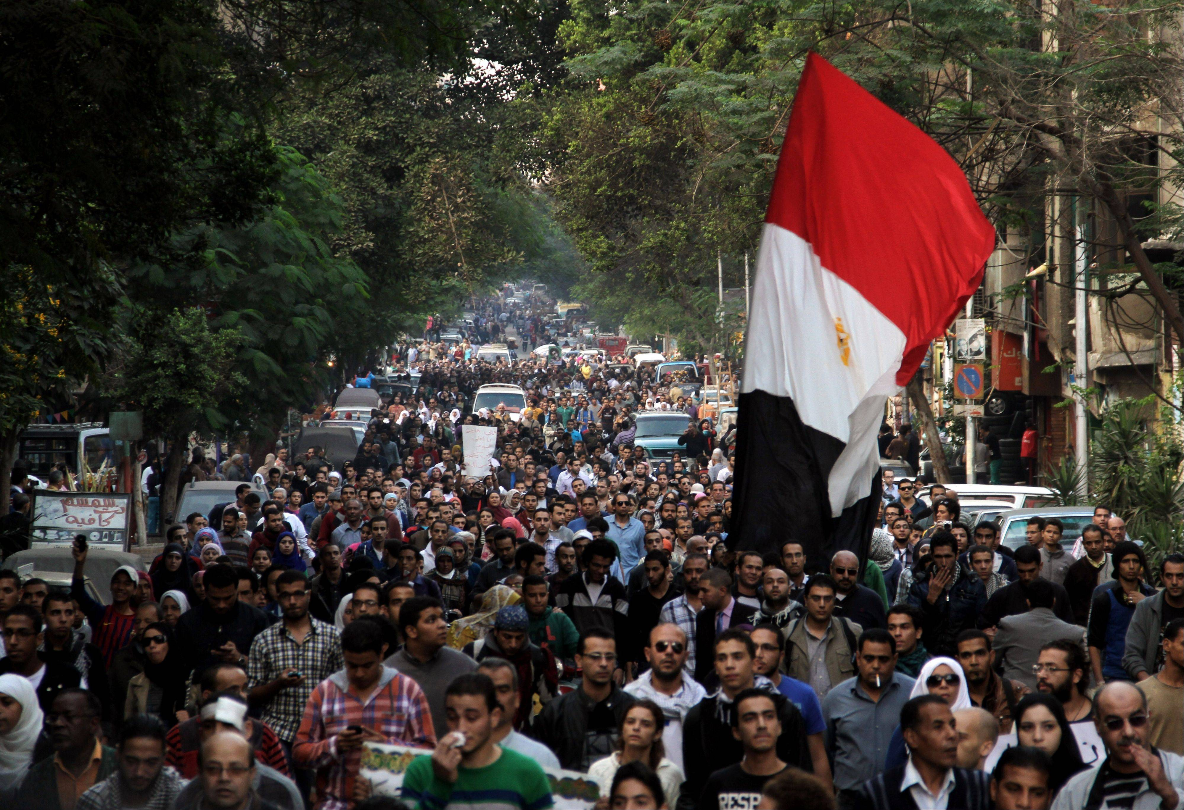 Thousands of Egyptians attend the funeral of Gaber Salah, who was who was killed in clashes with security forces in Cairo, Monday.