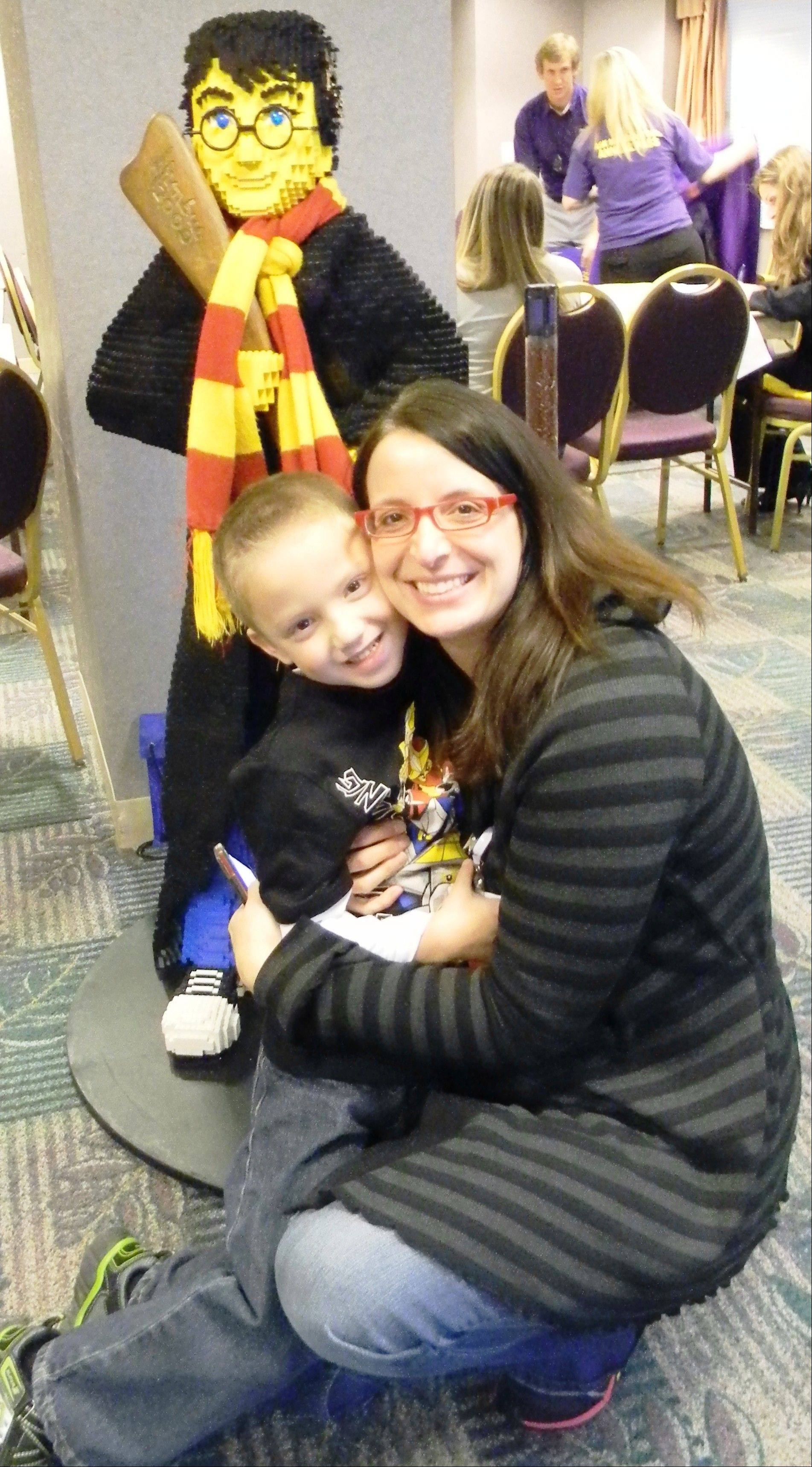 "Owen Jordan and his mother, Lisa Jordan, of Arlington Heights, hug at a Legoland Discovery Center Chicago event at St. Alexius Medical Center in Hoffman Estates. Three dozen children in the hospital's community helped set a Guinness World Record for having the ""Largest Toy Construction Lesson"" on Nov. 15."