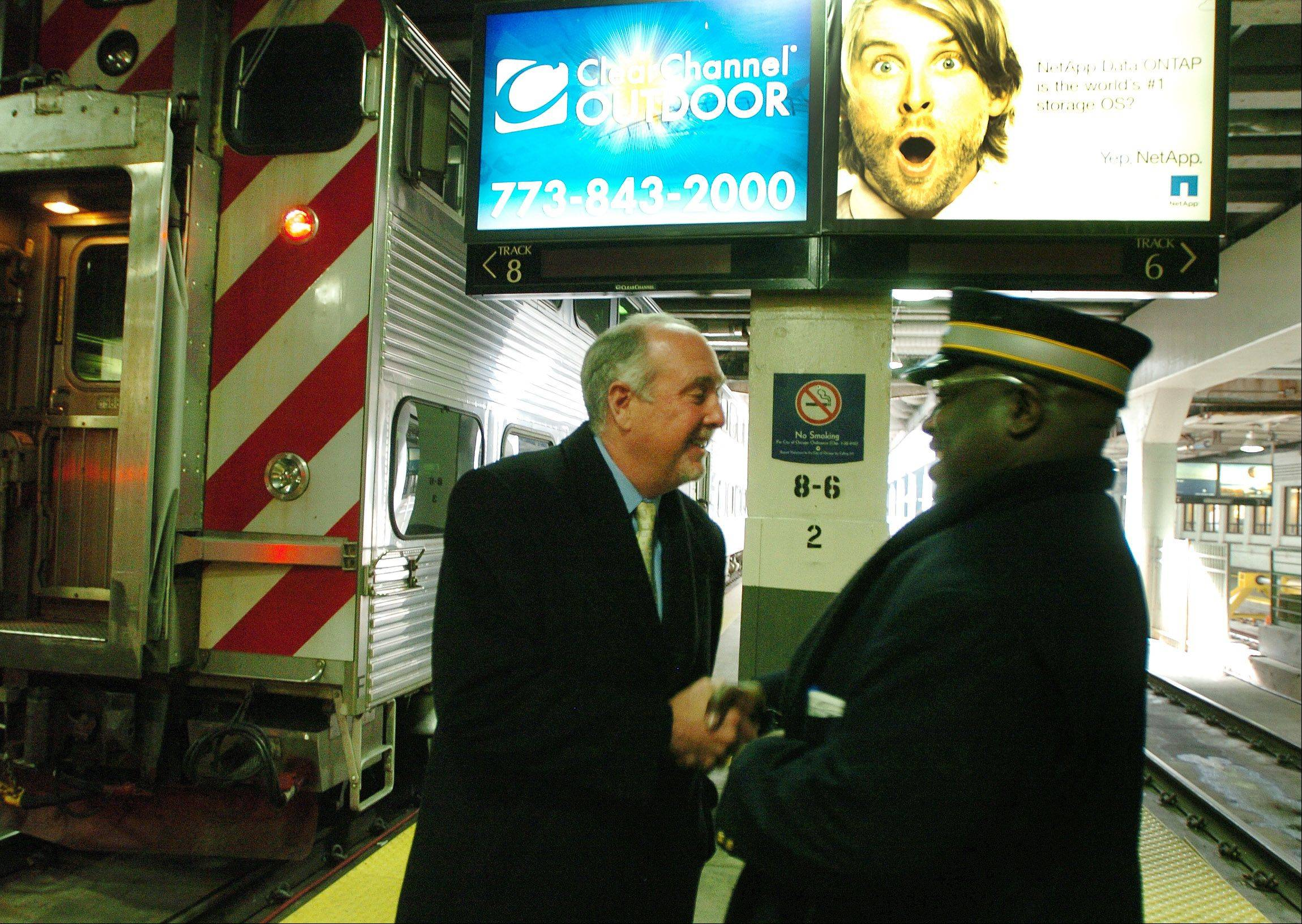 New Metra Chairman Brad O'Halloran talks with conductor William Sullivan inside Union Station.