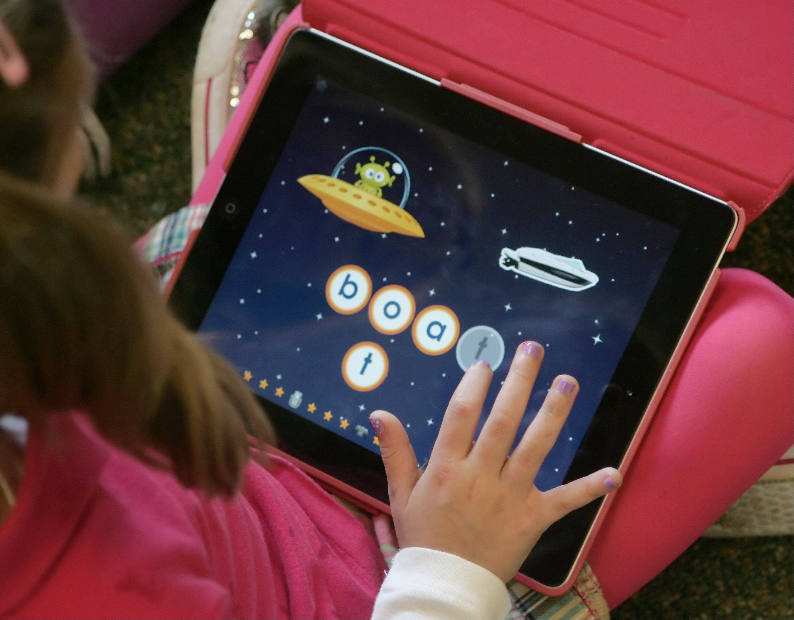 Apple iPad tablet computers are being used by students across the suburbs -- even kindergartners.
