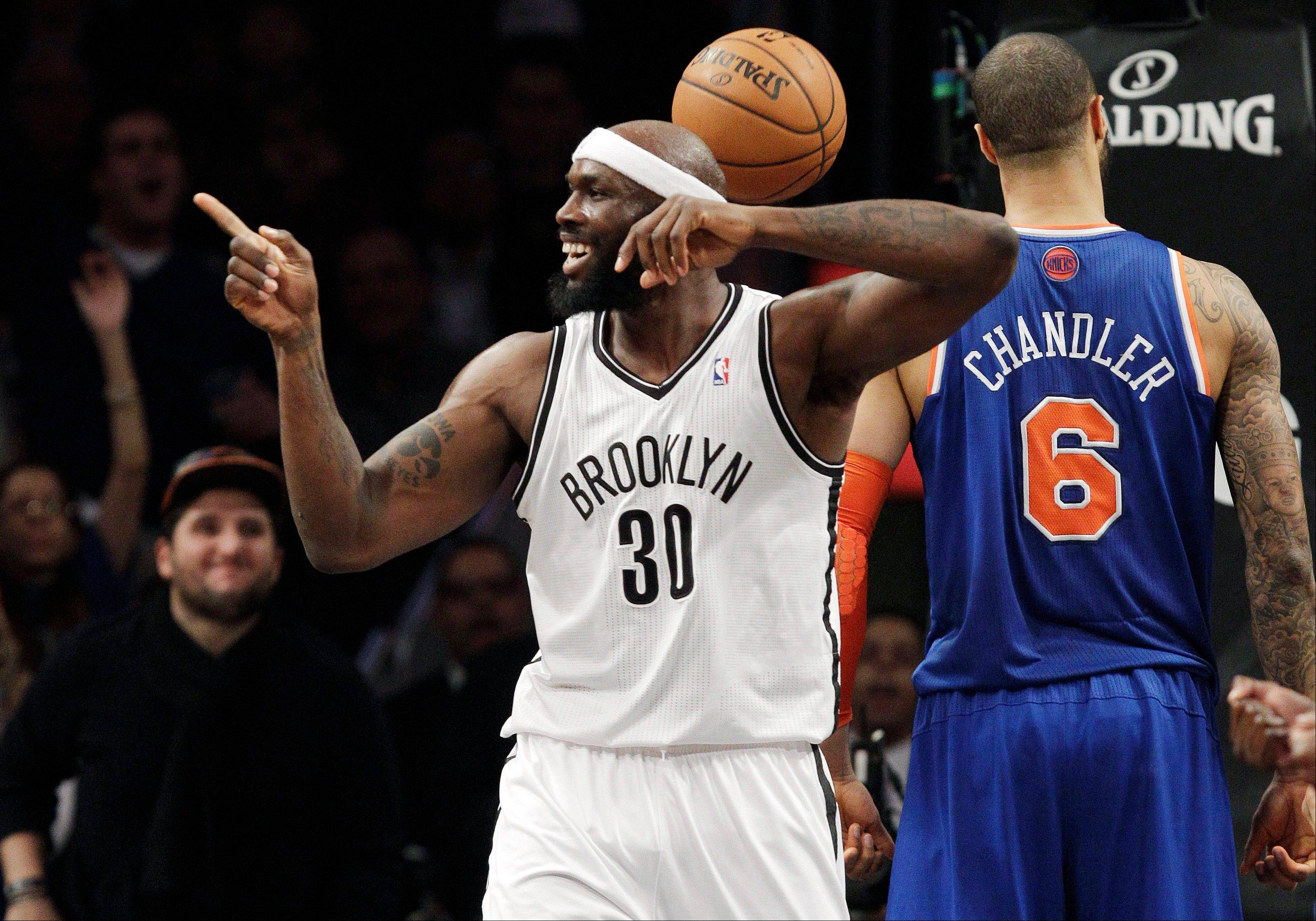 Brooklyn Nets forward Reggie Evans (30) reacts after blocking a shot by New York Knicks center Tyson Chandler (6) in the first half of their NBA basketball game at Barclays Center, Monday, Nov. 26, 2012, in New York. The Nets won 96-89 in overtime.