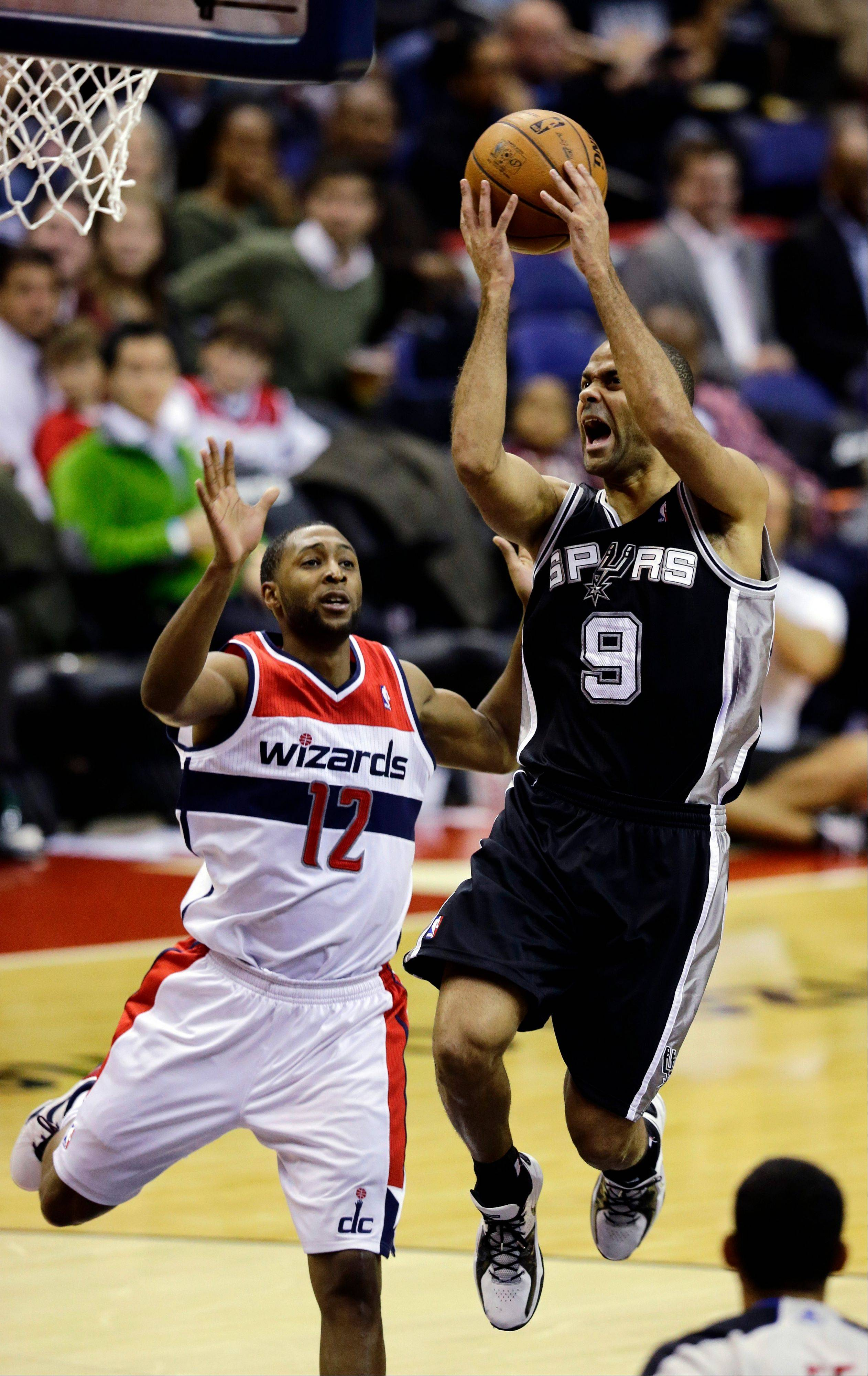 San Antonio Spurs guard Tony Parker shoots past Washington Wizards guard A.J. Price in the second half of an NBA basketball game Monday, Nov. 26, 2012, in Washington. The Spurs won 118-92. The Wizards are now 0-12.