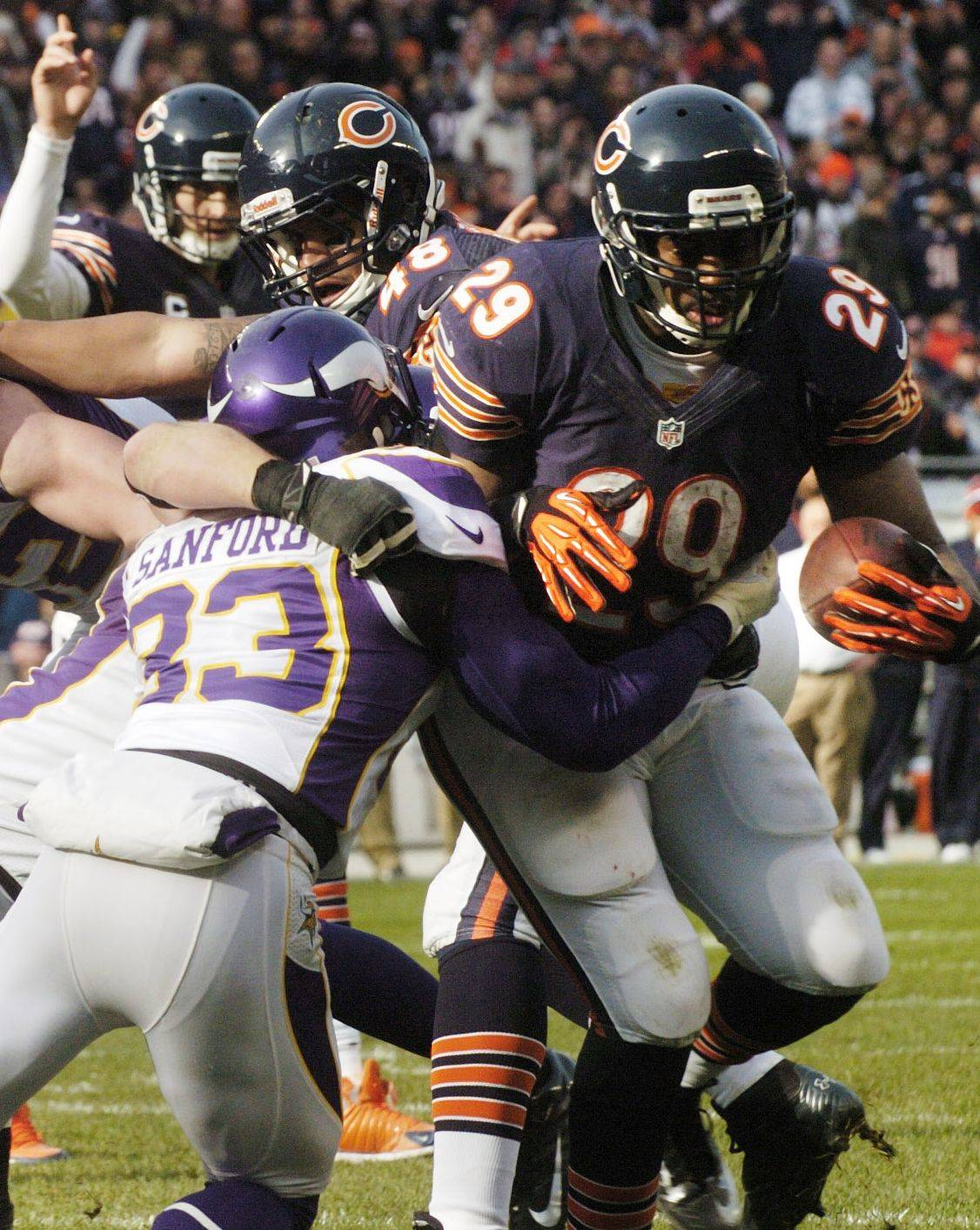 Michael Bush carries the ball for a second-quarter touchdown as he gets past Vikings strong safety Jamarca Sanford. Bush is in line for a heavy workload if Matt Forte can't go next week against the Seahawks.