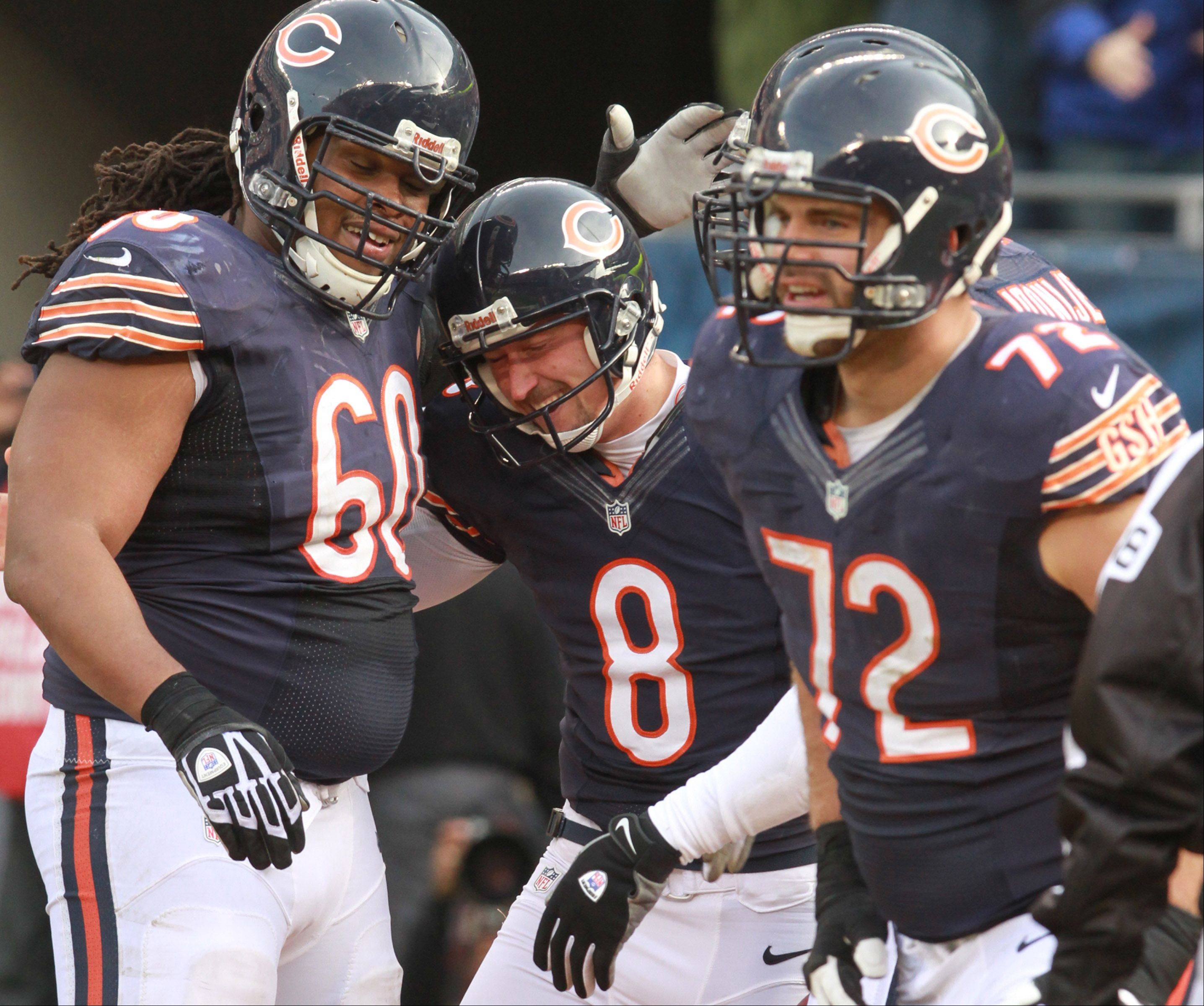Chicago Bears linemen Lance Louis, left, and Gabe Carimi, right, celebrate a 2-point conversion by extra-point holder Adam Podlesh at Soldier Field Sunday. Louis suffered a knee injury in the second half that will keep him out the rest of the season.