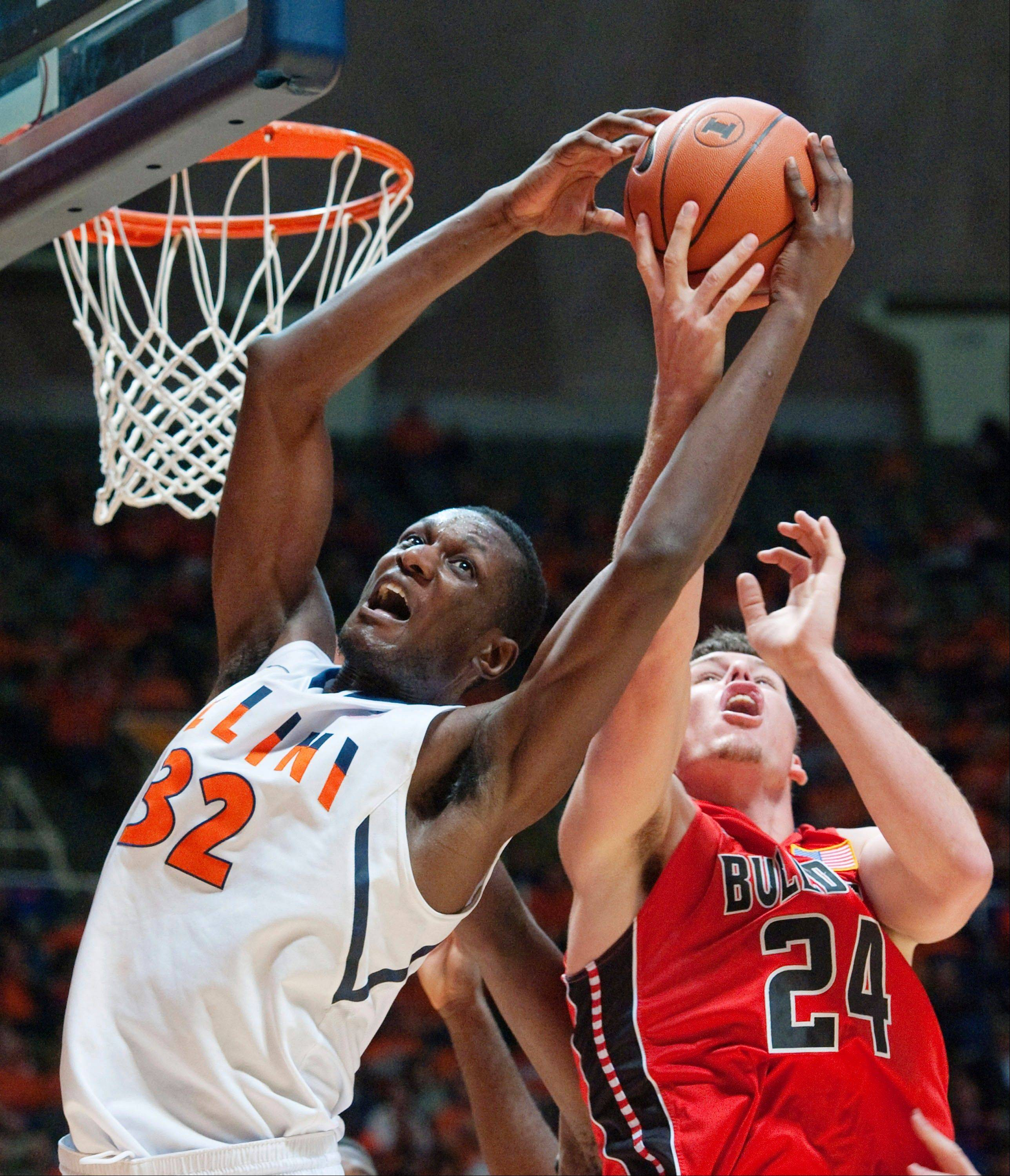 Illinois center Nnanna Egwu (32) and Gardner-Webb's Kevin Hartley (24) fight for a rebound in Champaign on Sunday. Illinois squeaked by with a 63-62 win and is ranked No. 22 by The Associated Press.