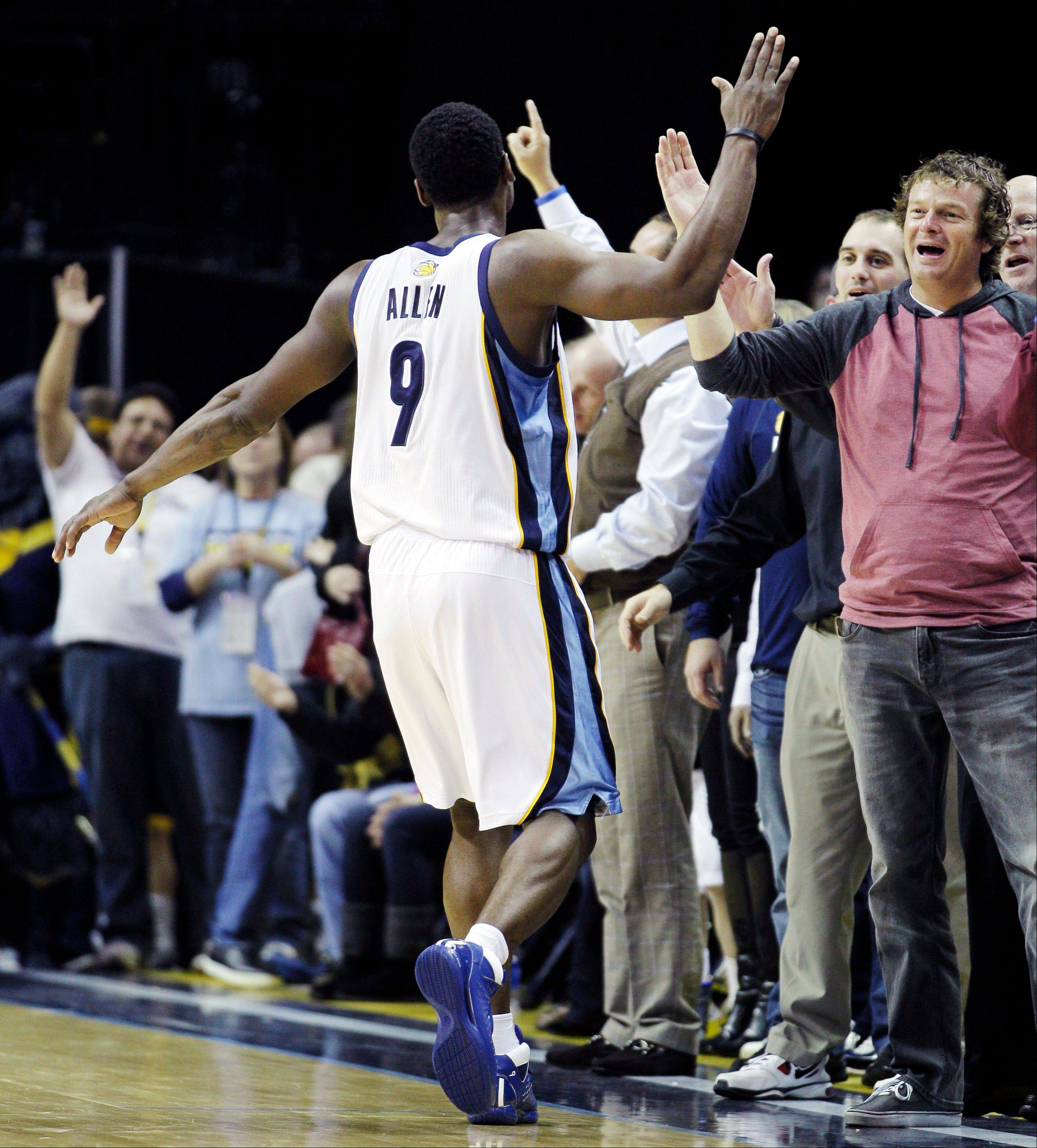Memphis Grizzlies fans cheer and greet Memphis Grizzlies' Tony Allen during a timeout late in the second half of an NBA basketball game against the Cleveland Cavaliers in Memphis, Tenn, Monday, Nov. 26, 2012. The Grizzlies won 84-78.