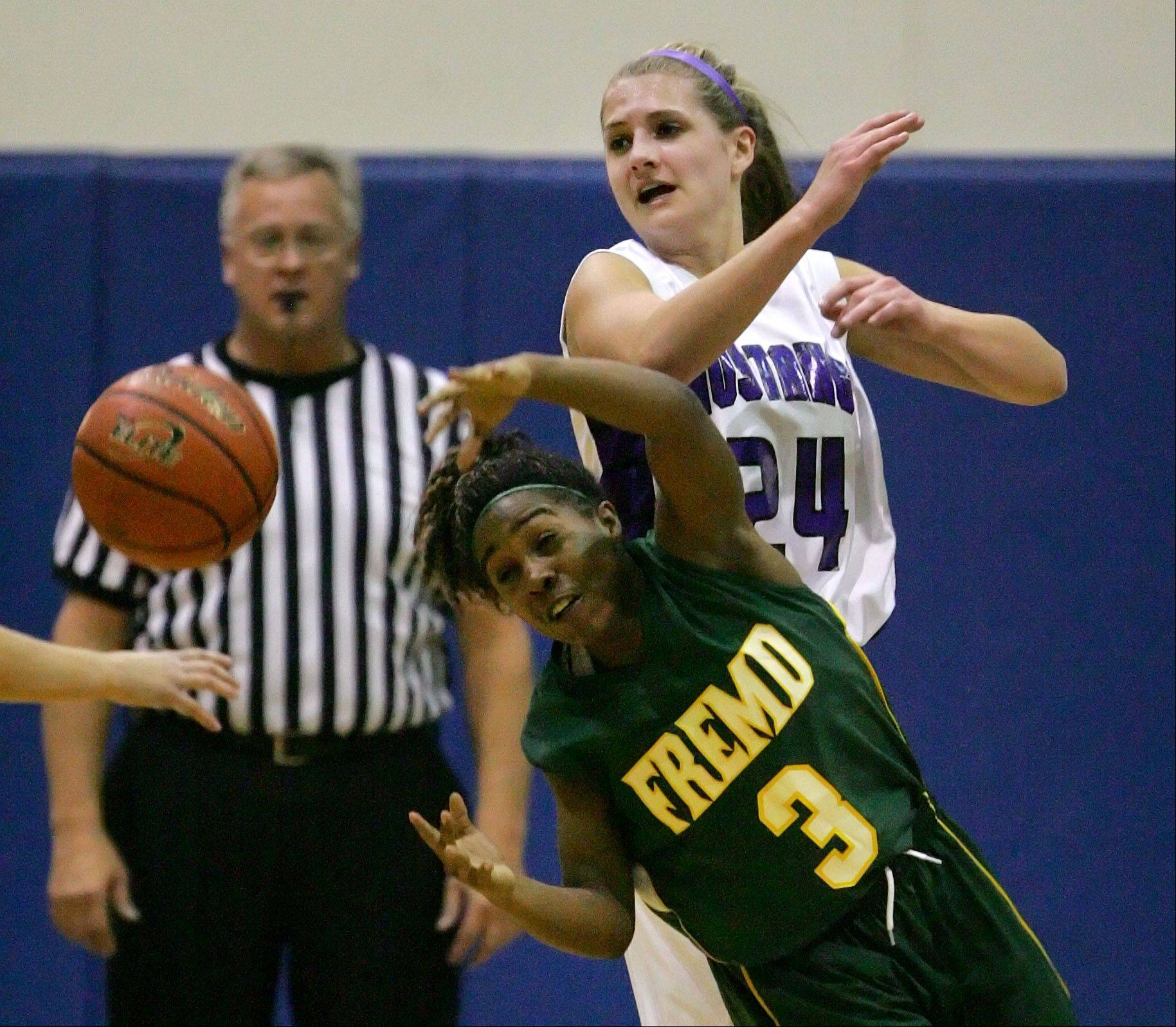Rolling Meadows' Alexis Glasgow, right, and Fremd's Brianna Lewis chase a loose ball during their game Wednesday night at Lake Zurich High School.