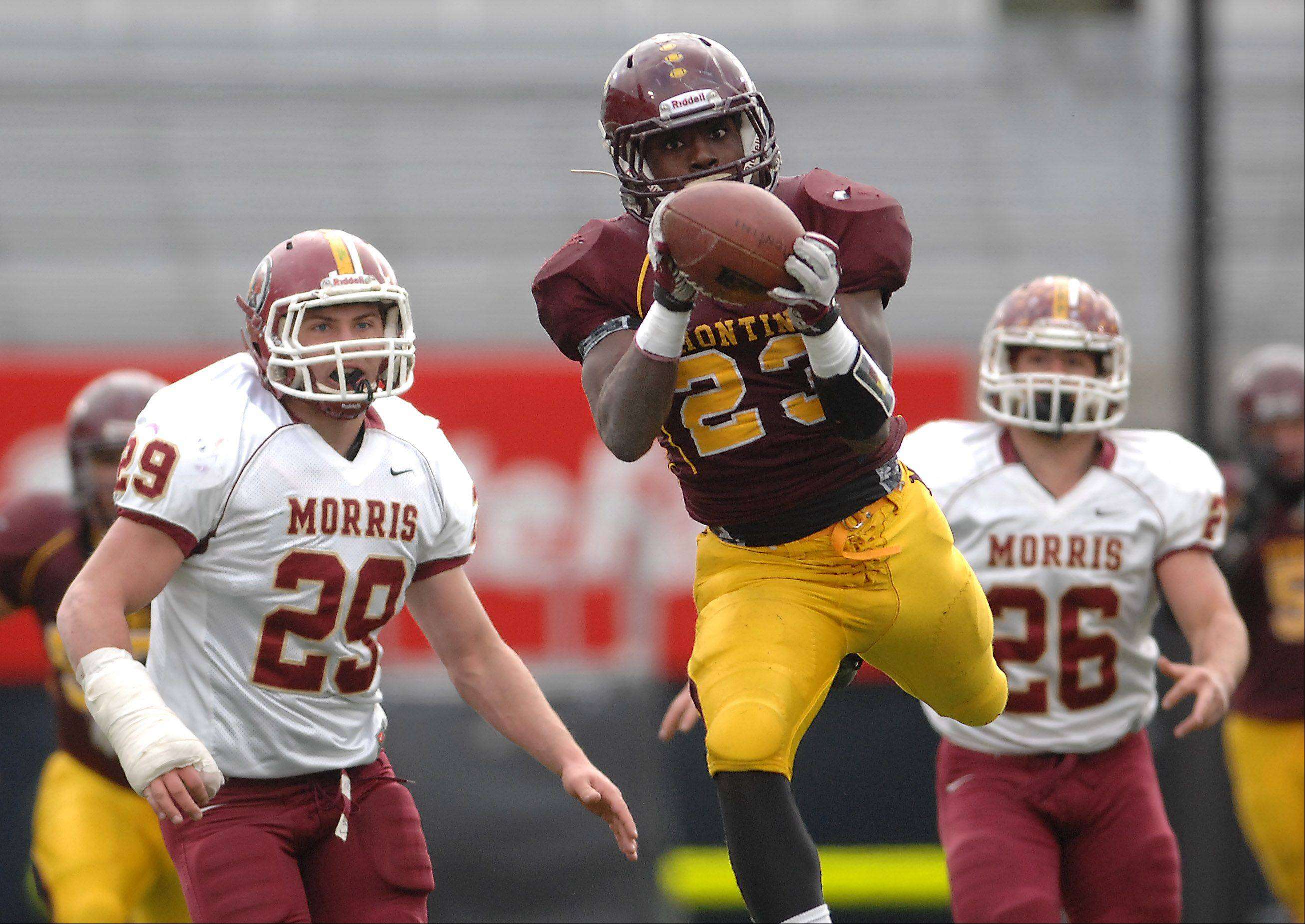 Montini's Dimitri Taylor, 23, hauls in a pass during Saturday's Class 5A state title game against Morris at Memorial Stadium in Champaign.