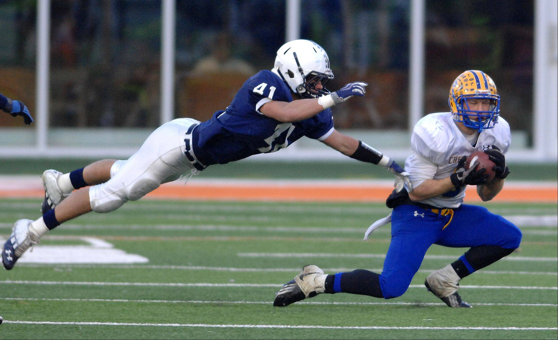 Cary-Grove's Zach Marszal, 41, attempts to break up a Crete-Monee play during Saturday's Class 6A state title game at Memorial Stadium in Champaign.