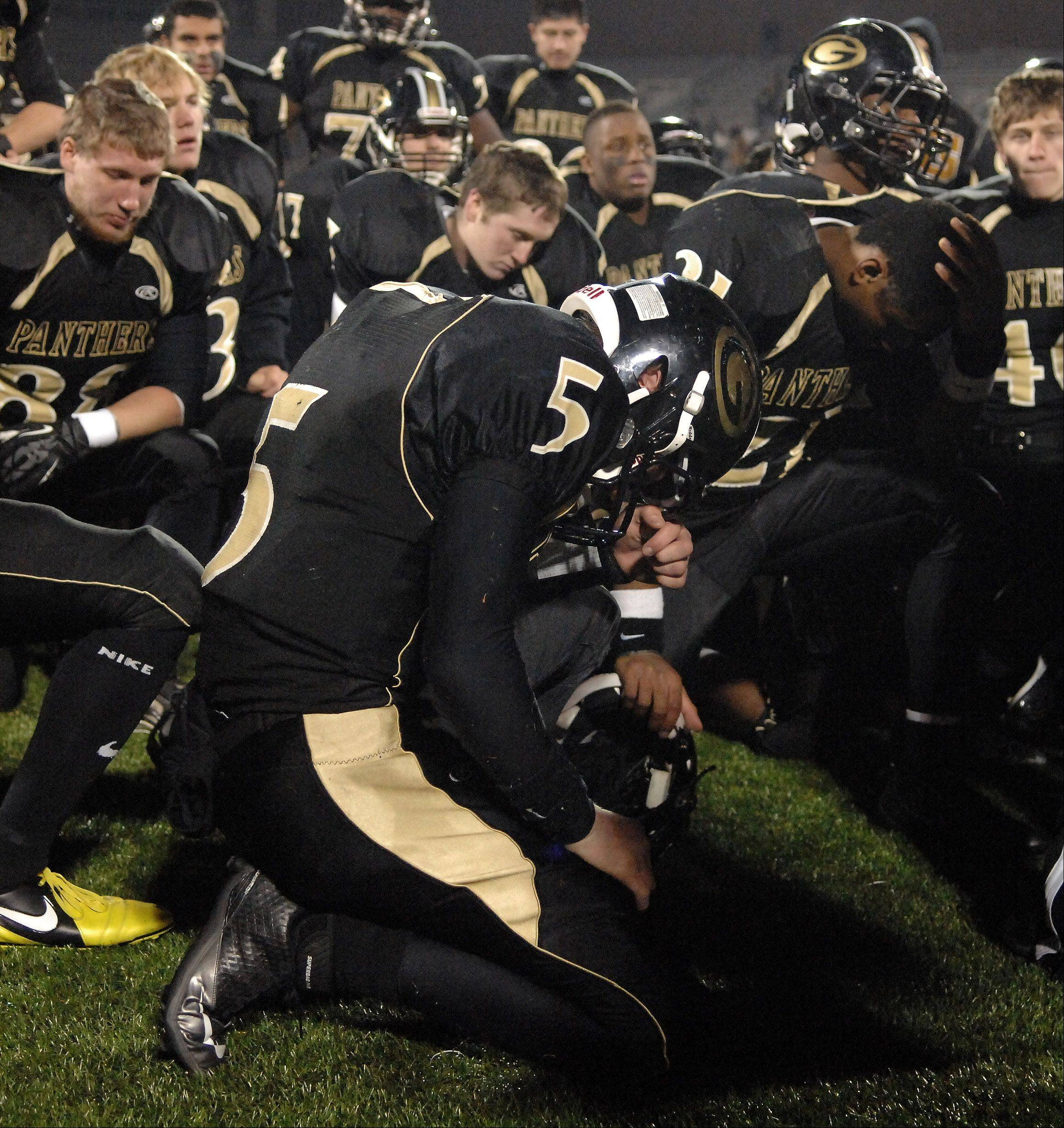 Glenbard North's Brian Murphy bows his head following the Panthers loss to Mt. Carmel during Saturday's Class 8A state title game at Memorial Stadium in Champaign.