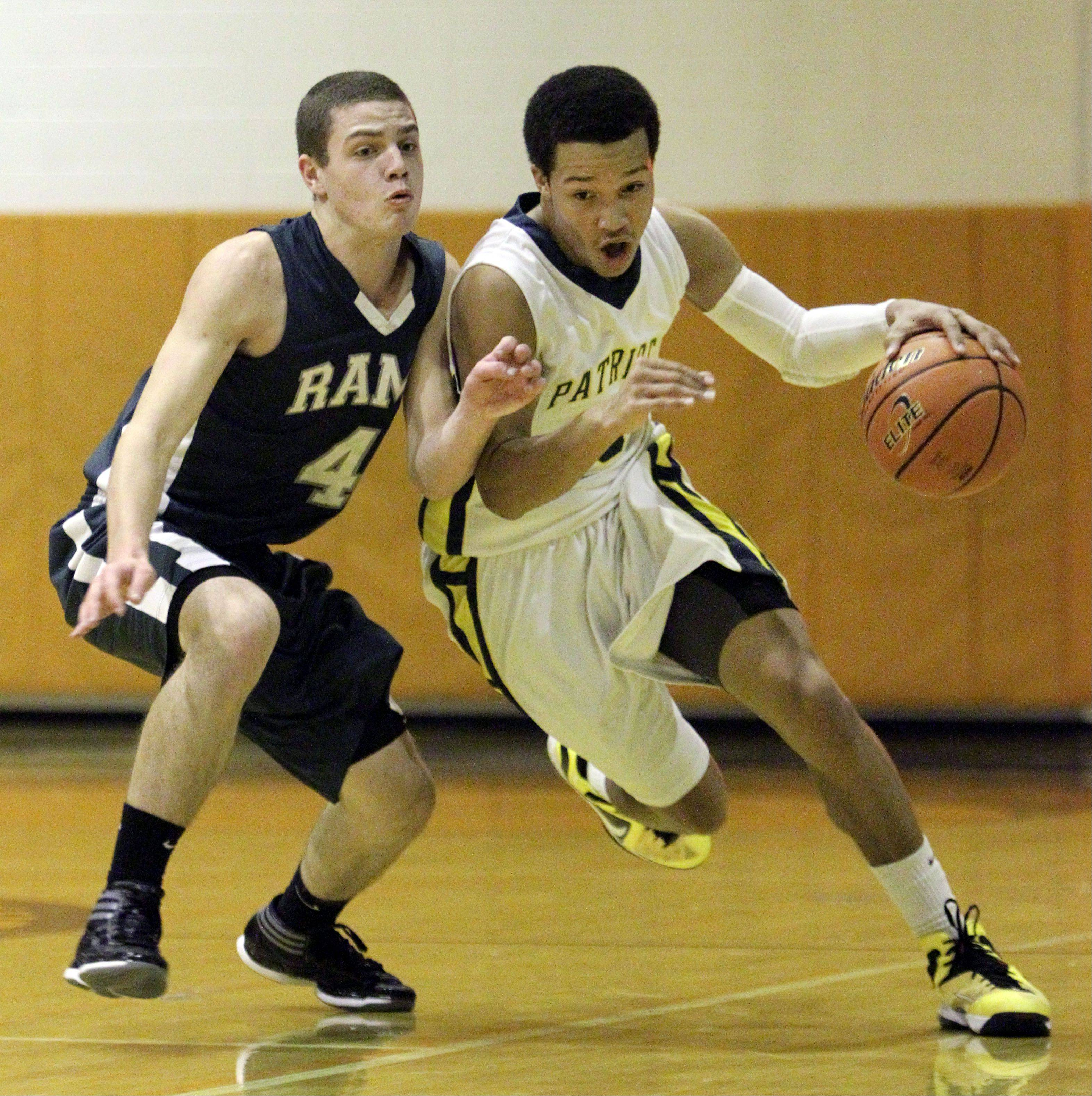 Stevenson's Jalen Brunson, right, drives on Grayslake Central's Jacob Vargo during their game at the Bison Classic Thanksgiving Tournament Monday.
