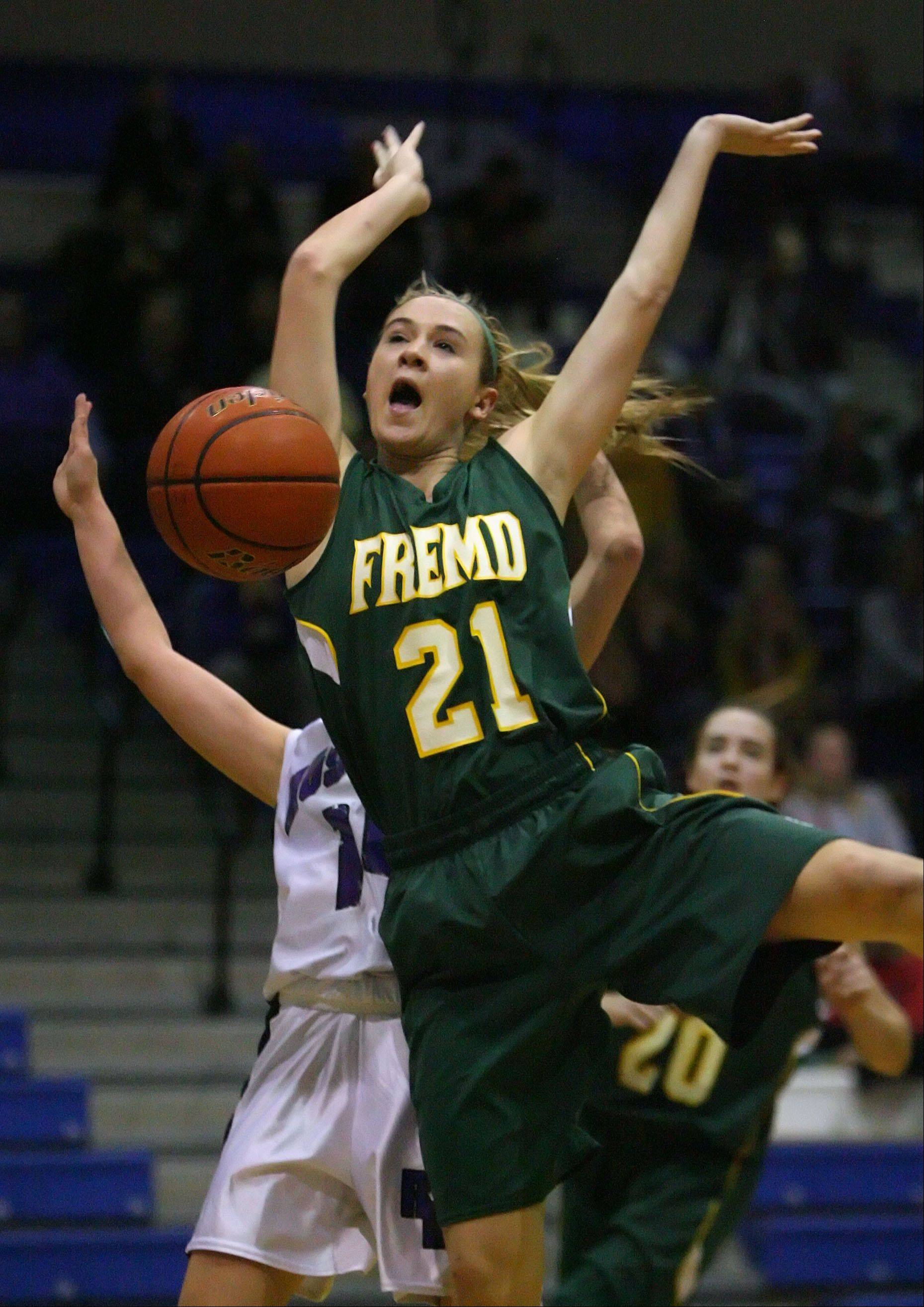 Fremd's Ashley McConnell gets the ball stripped by Rolling Meadows' Sami Kay as she drives to the hoop during their game Wednesday night at Lake Zurich High School.