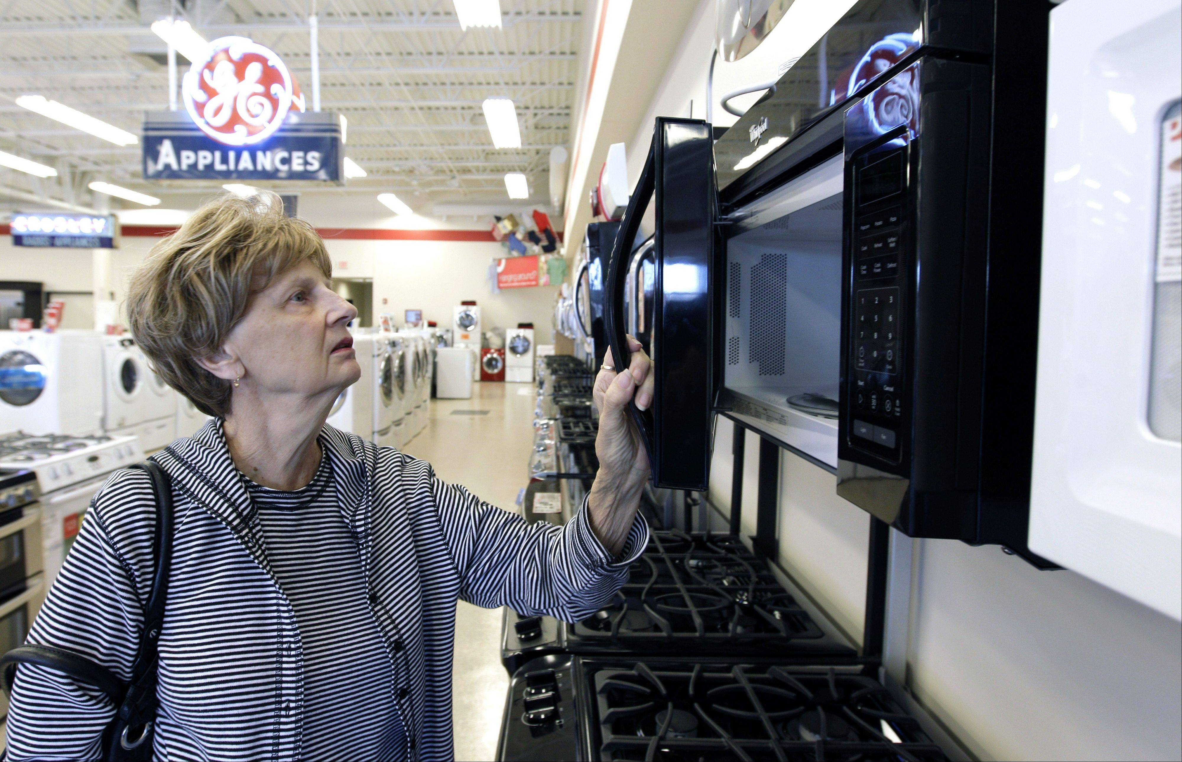 Mary Ann Rotolo shops for a microwave oven at Orville�s Home Appliances store in Amherst, N.Y. U.S. companies in October increased their orders of machinery and equipment that signal investment plans by the largest amount in five months, a hopeful sign for future economic growth.