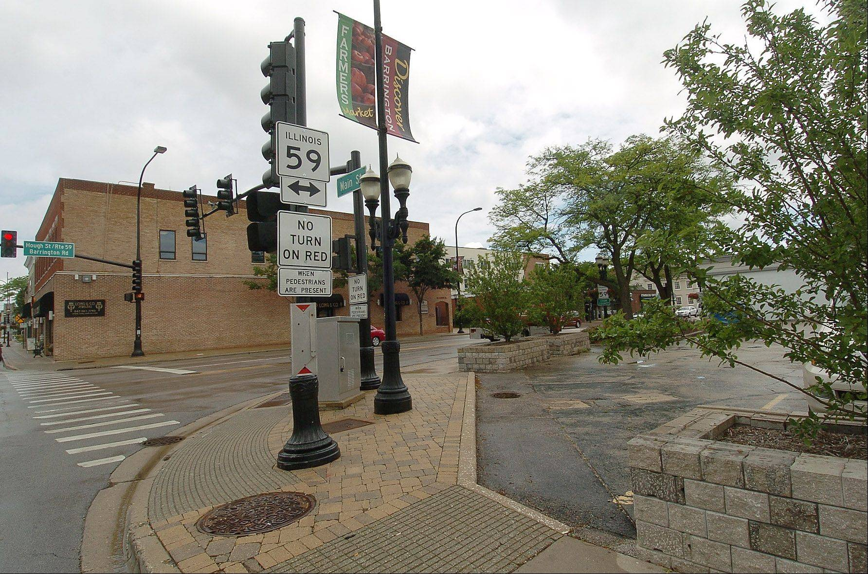 Debate continues over plans to redevelop the corner of Hough and Main Streets in downtown Barrington. Opponents of the current plan, which calls for a mix of retail and office space, say it lacks the residential component needed to help the downtown flourish.