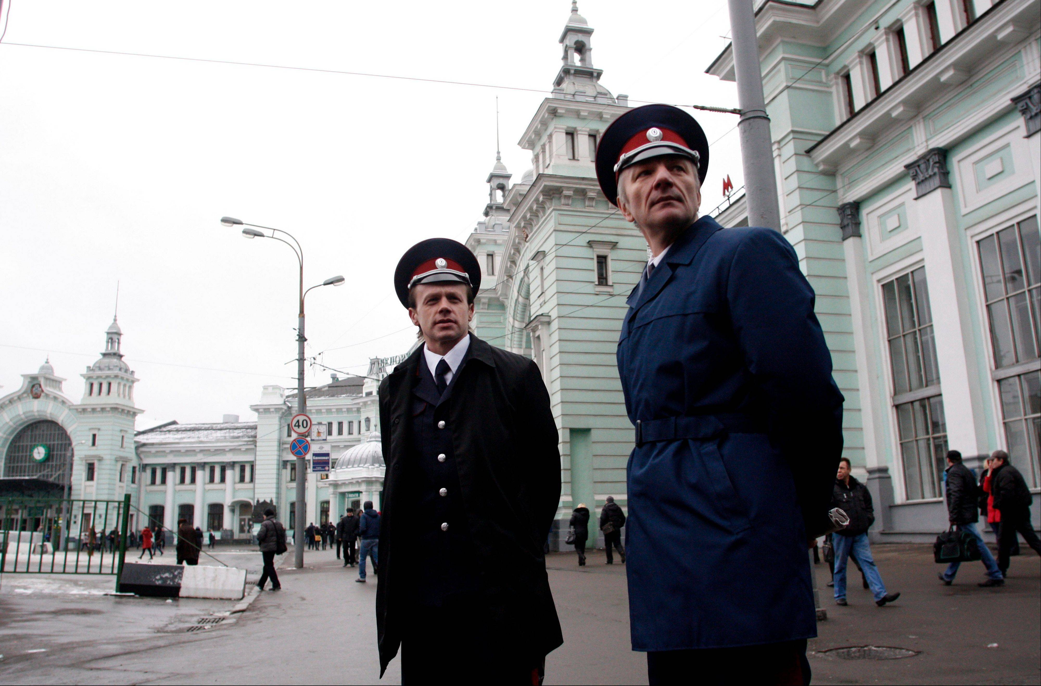 Two Russian Cossacks watch pedestrians passing by as they patrol Belorussky railway station in downtown Moscow, Russia, Tuesday, Nov. 27, 2012. Renowned for their sword-fighting prowess and anti-Semitism in czarist Russia, the Cossacks are taking on new foes: beggars, drunks, unlicensed traders and improperly parked cars.