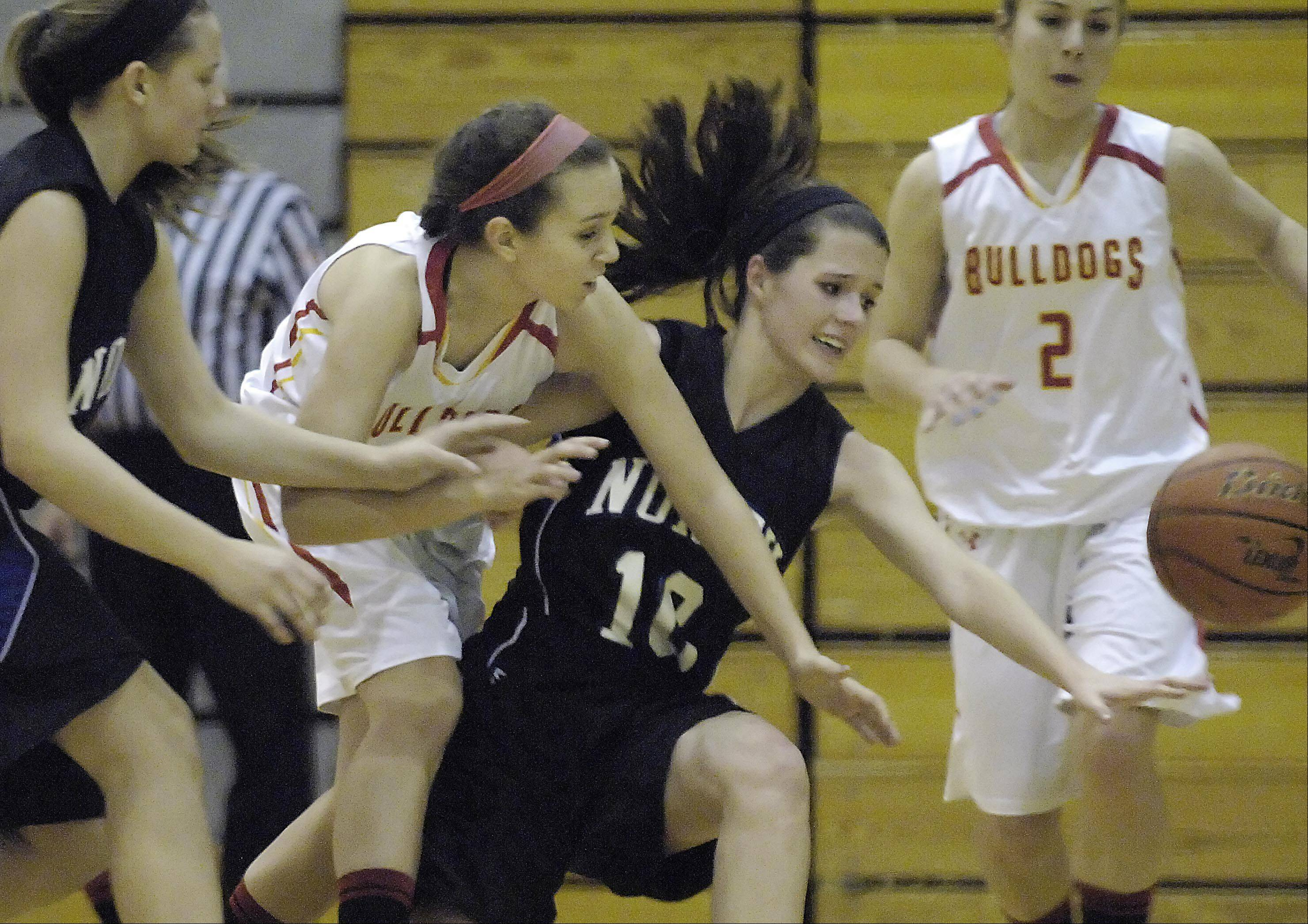 St. Charles North's Ashling Davern and Batavia's Bethany Orman, left, battle for a loose ball .