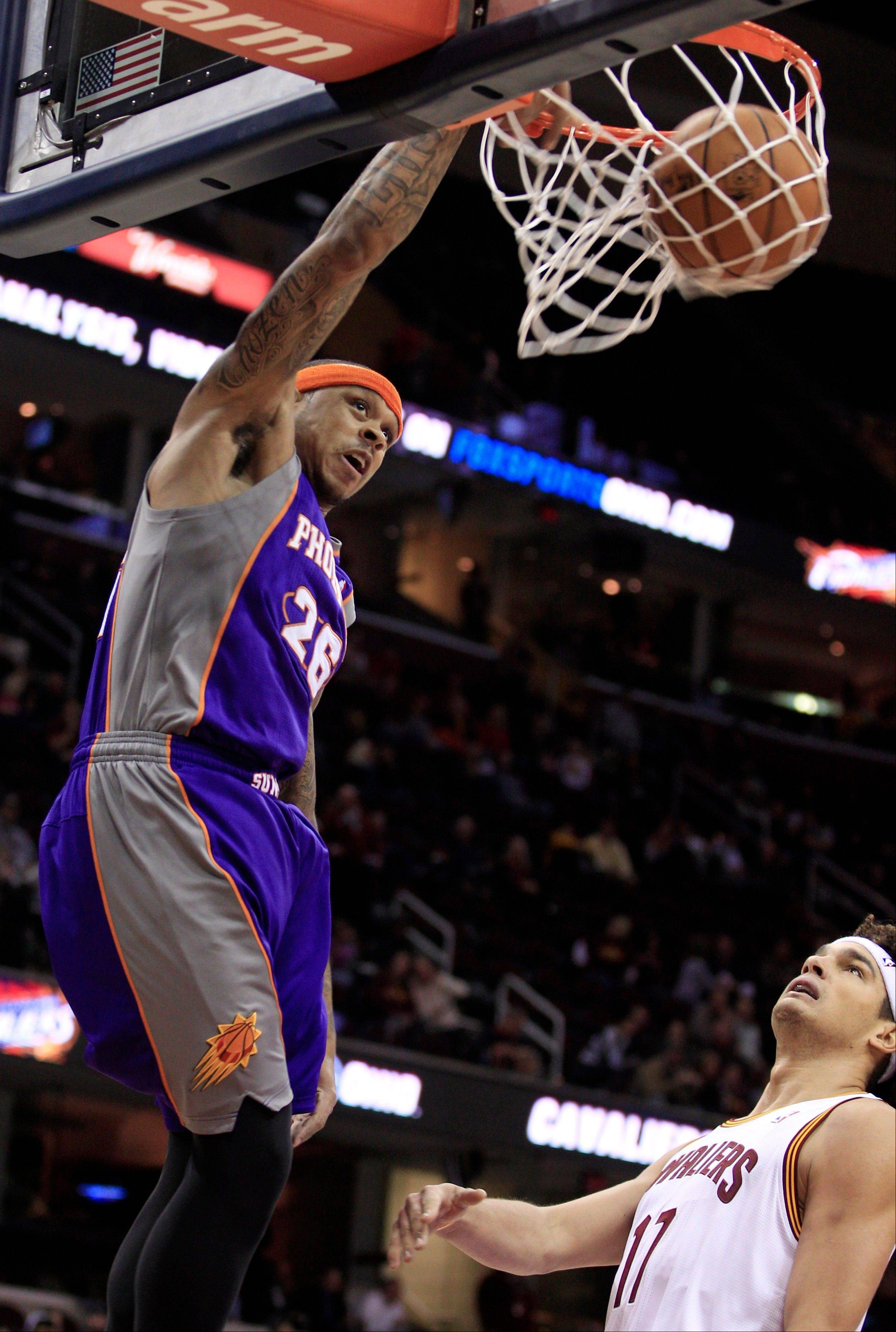 The Phoenix Suns� Shannon Brown dunks in front of the Cleveland Cavaliers� Anderson Varejao Tuesday during the first quarter in Cleveland.