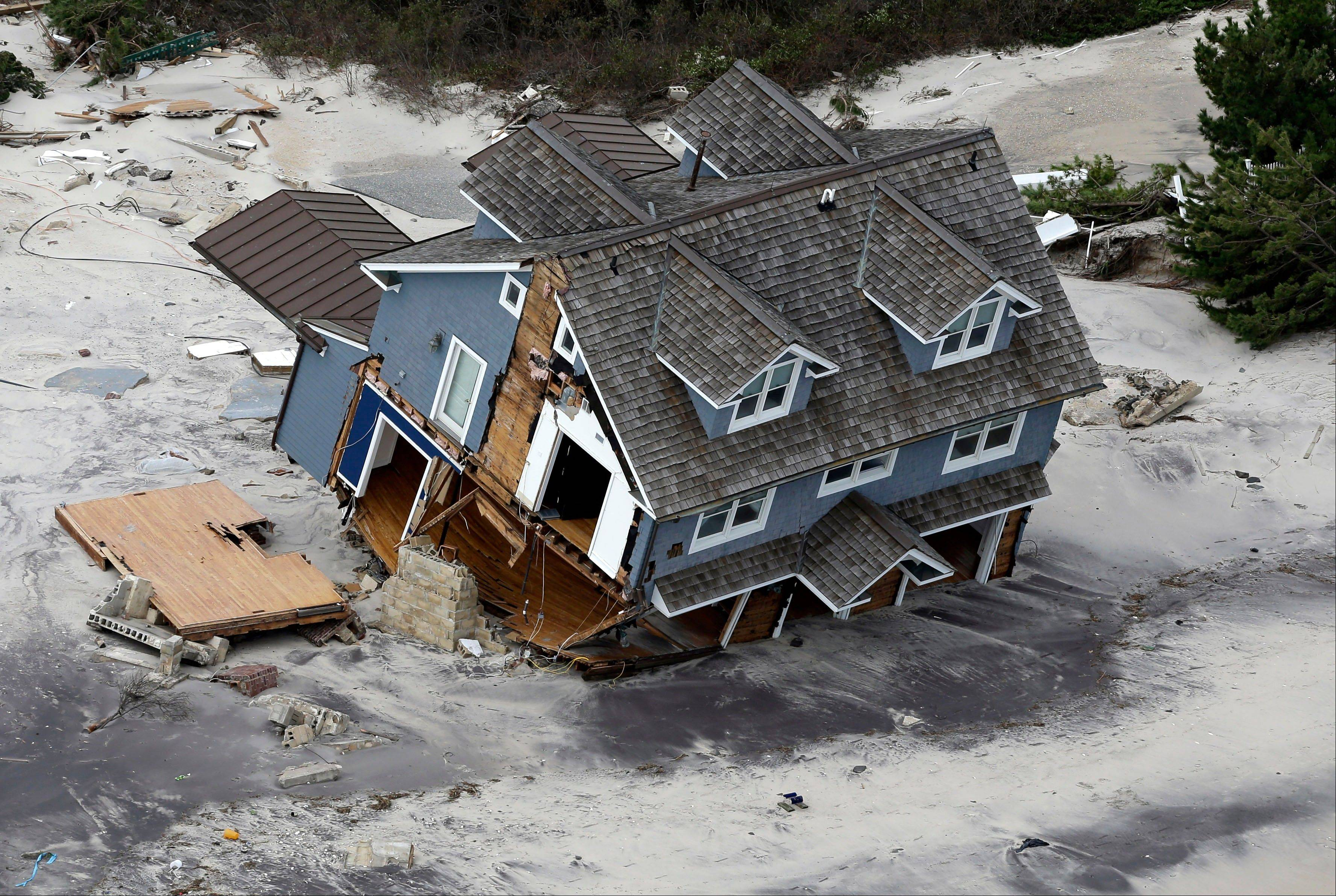 "A collapsed house is seen along the central Jersey Shore coast on Oct. 31. Though it's tricky to link a single weather event to climate change, Hurricane Sandy was ""probably not a coincidence"" but an example of extreme weather events likely to strike the US more often as the world gets warmer, the U.N. climate panel's No. 2 scientist said Tuesday."
