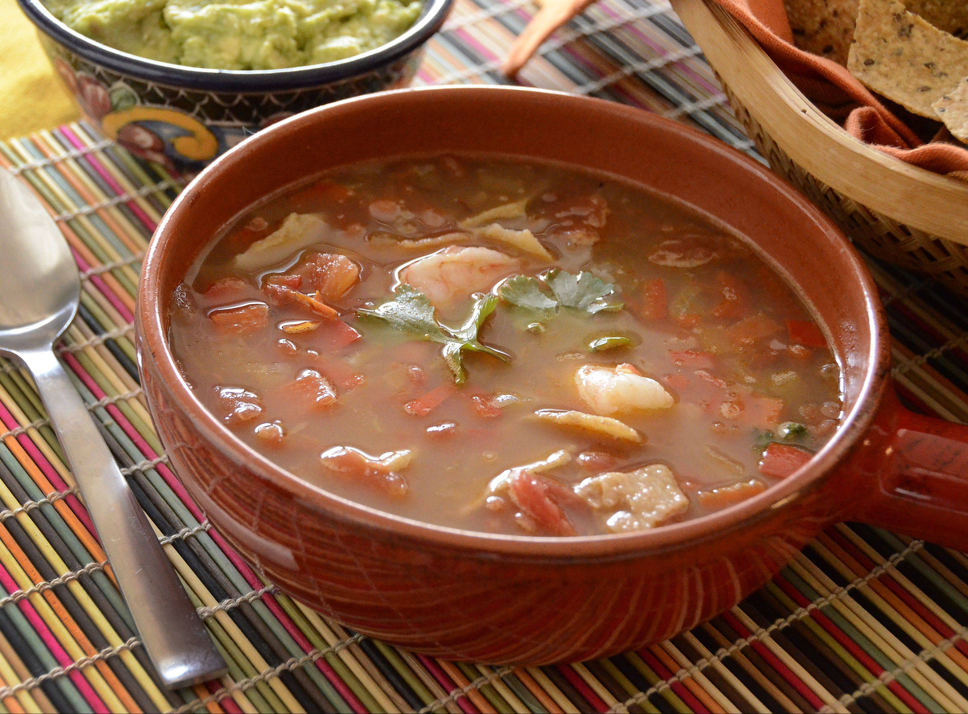 A bit of cocoa powder adds mole-like depth to shrimp-studded tortilla soup.