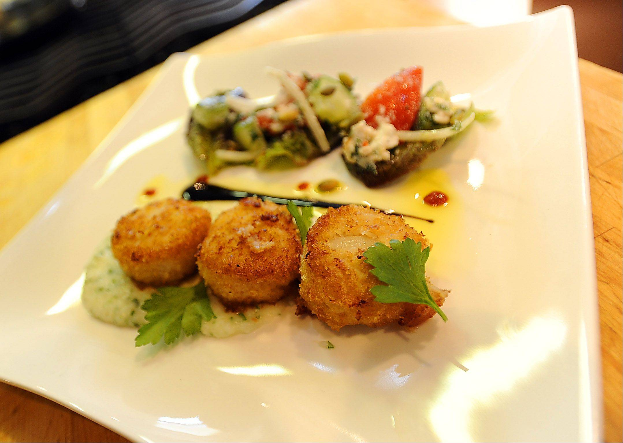 Chef John Reed of Customized Culinary Solutions in Skokie says crispy scallops with herb grits and Greek salad with toasted pumpkin seeds is quick and family-friendly dinner.