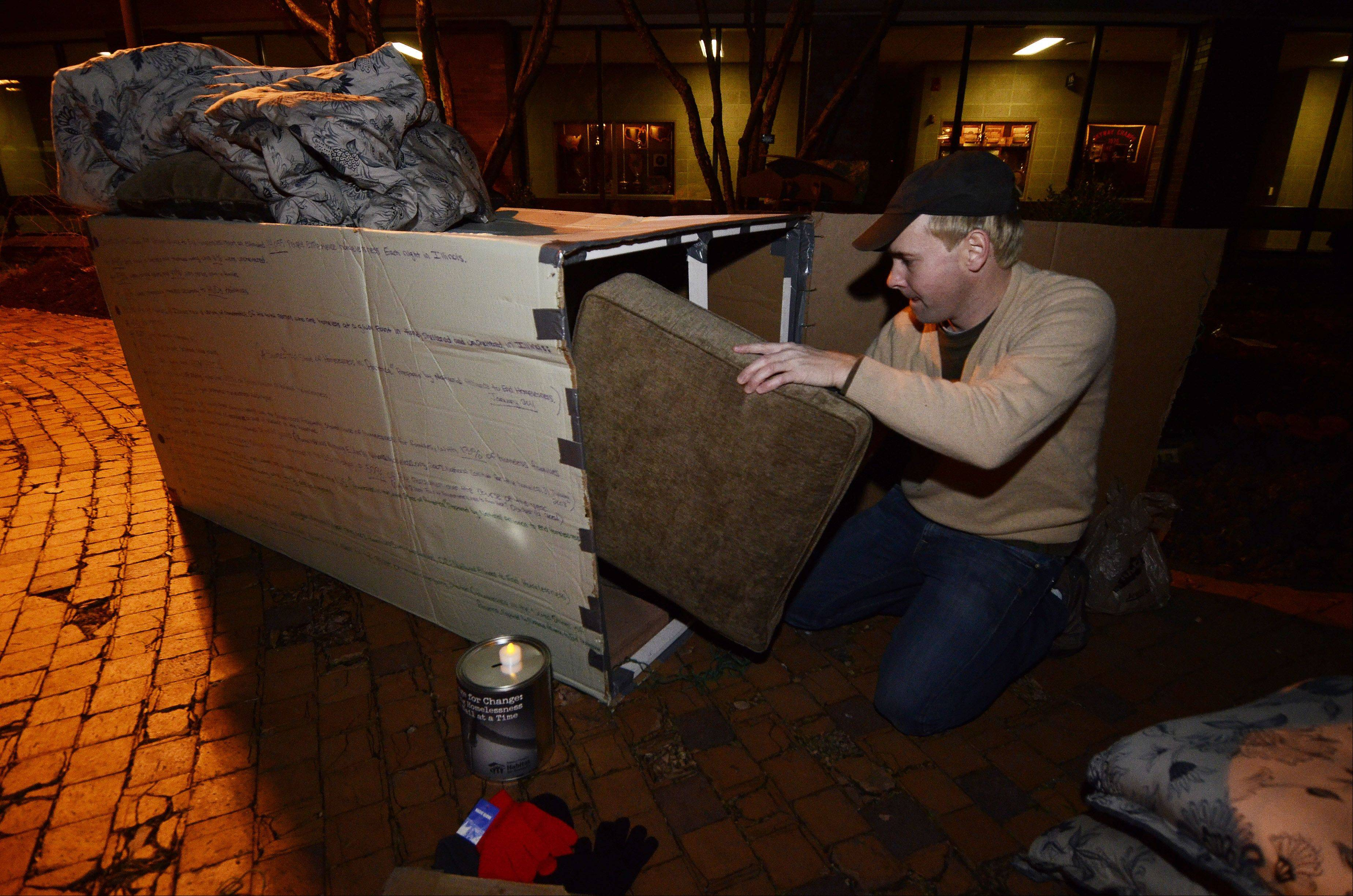 Brian York of Park Ridge prepares his cardboard dwelling for an overnight stay in the courtyard of Oakton Community College's Des Plaines campus Tuesday evening as part of an event to raise awareness for the plight of the homeless. York, now an Oakton student, was homeless two years ago after he suffered an on-the-job injury and his disability insurance ran out.