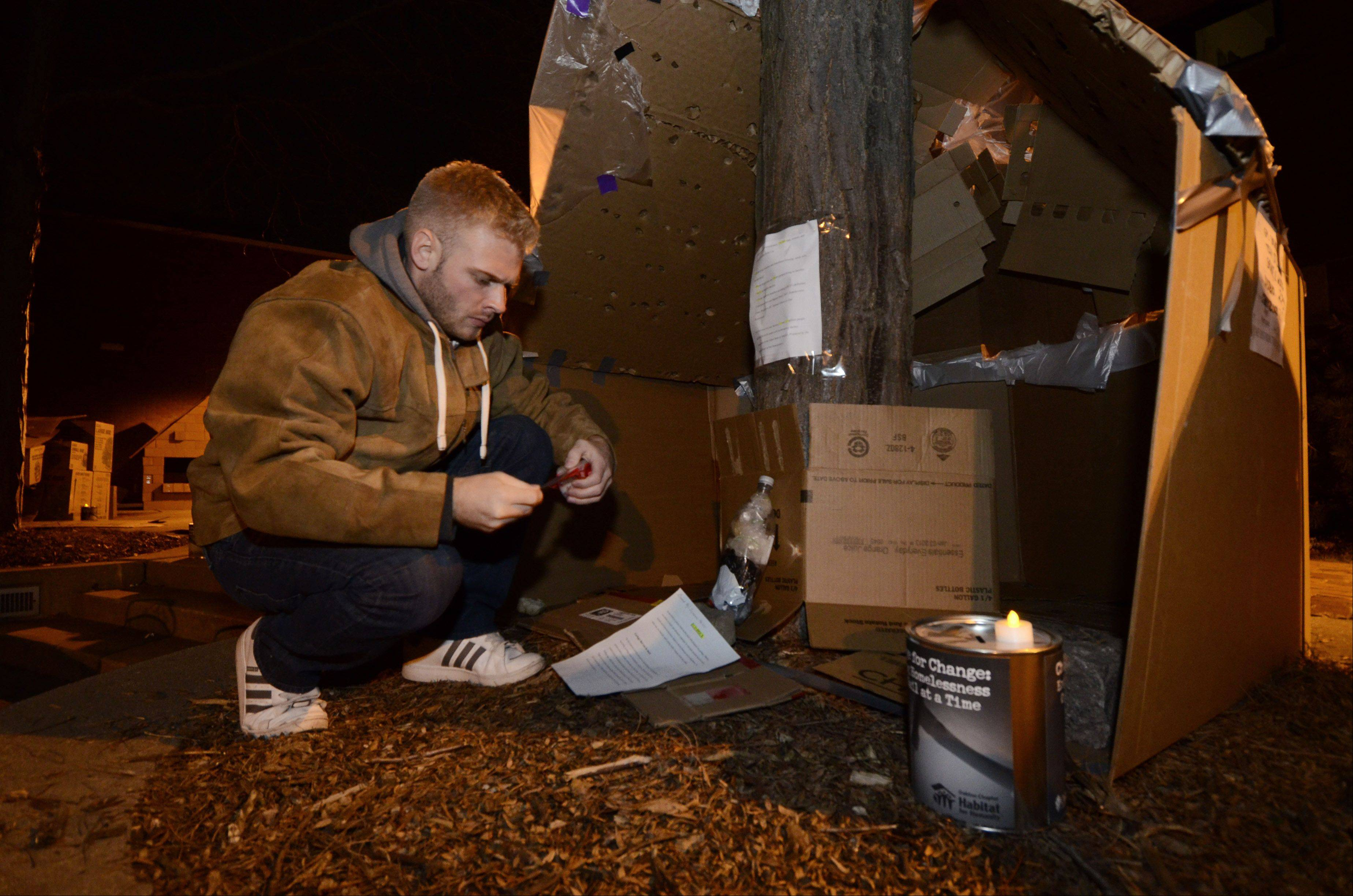 Oakton Community College student Andrew Ellis of Chicago prepares his cardboard dwelling for an overnight stay in the courtyard of Oakton Community College's Des Plaines campus. The college's chapter of Habitat for Humanity sponsored the event to raise awareness for the plight of the homeless.