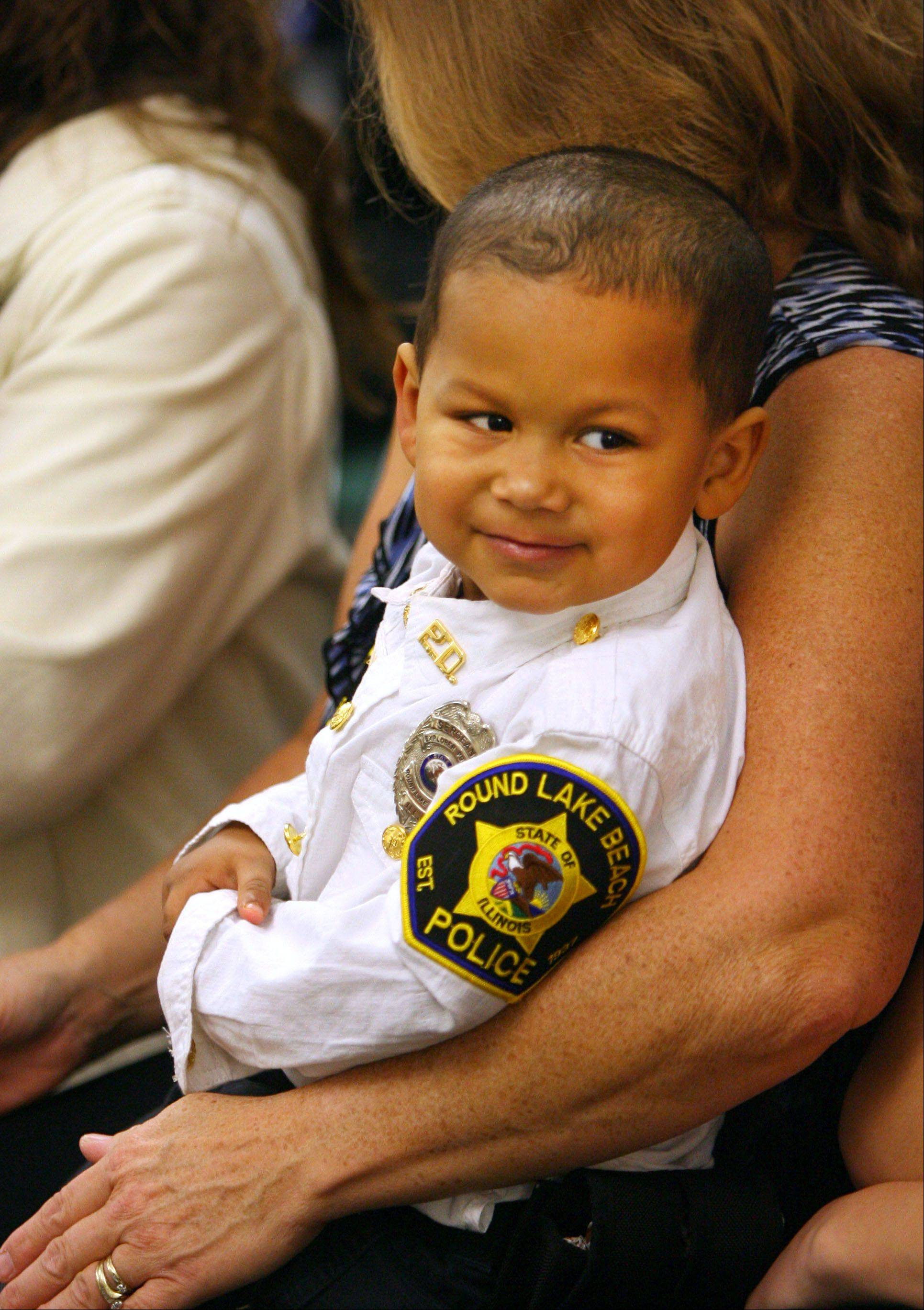 Mekhi Carter was all smiles after being recognized as a Junior Round Lake Beach Police Officer. The 3�-year-old was born with a heart condition and has had three open-heart surgeries. The department gave him a custom made police uniform for Halloween and followed up with the recognition.