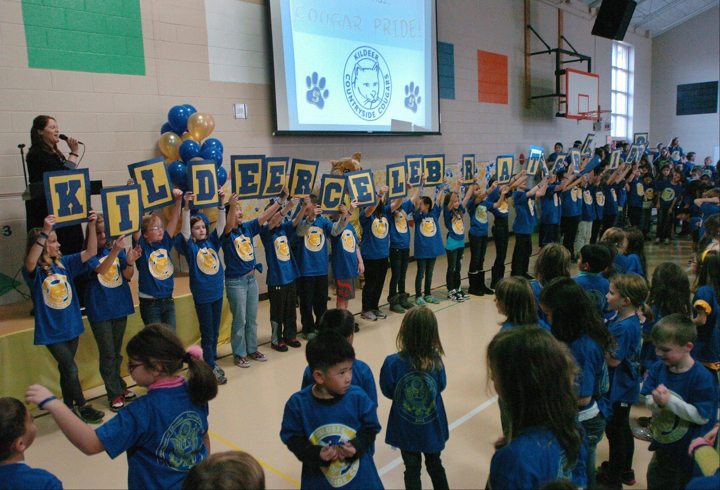 "Students form a sign saying ""Kildeer Celebrates Blue Ribbon."""