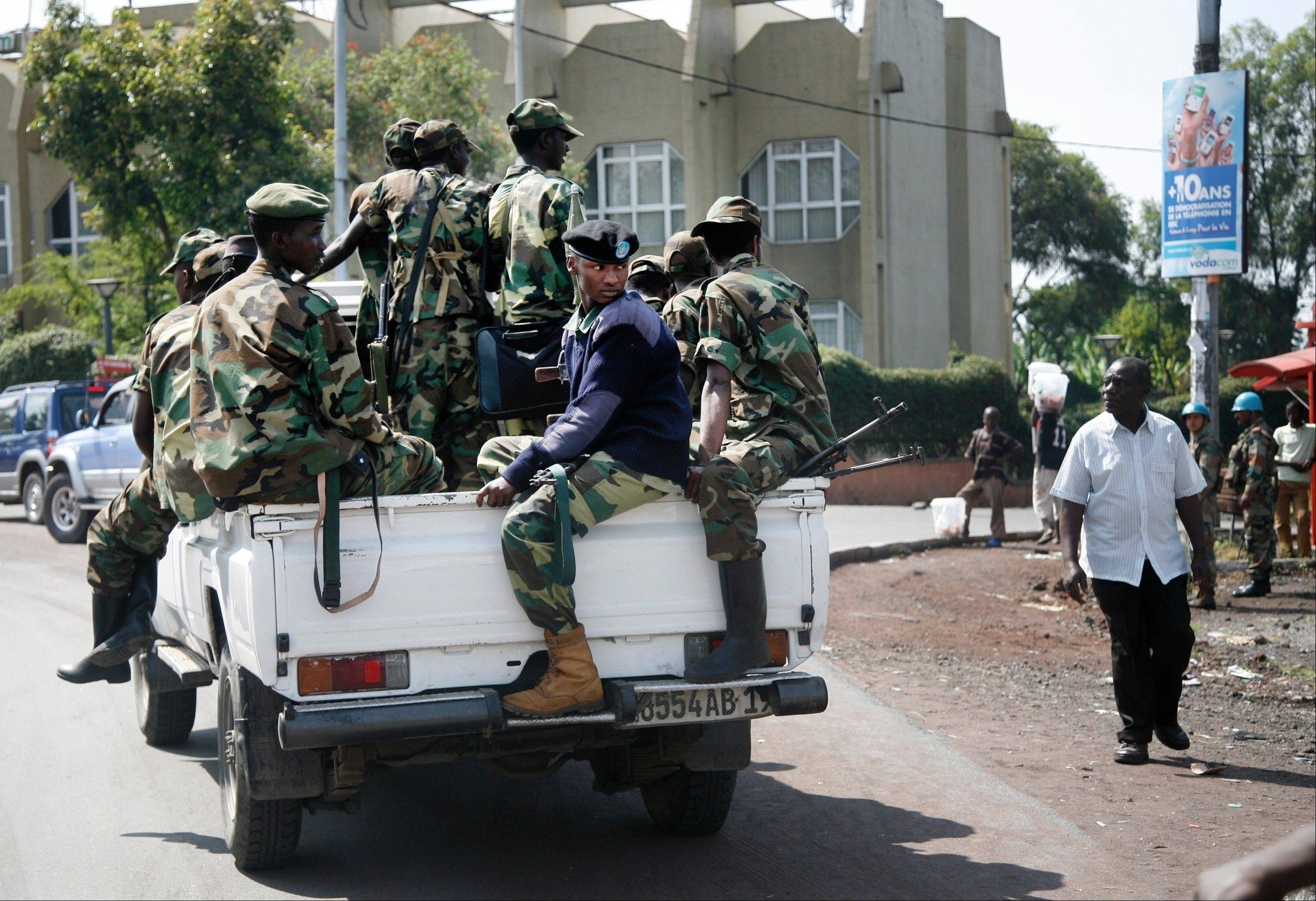 Congo's M23 rebels defied a deadline imposed by neighboring nations, saying Tuesday the insurgents will stay in the crucial, eastern city of Goma and will fight the Congolese army if it tries to retake it.