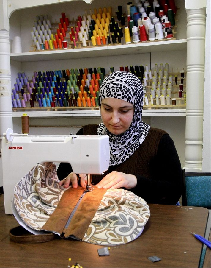 Gulnora Fozilova, a Turkish refugee from Russia, sews a messenger bag at Re:new in Glen Ellyn.