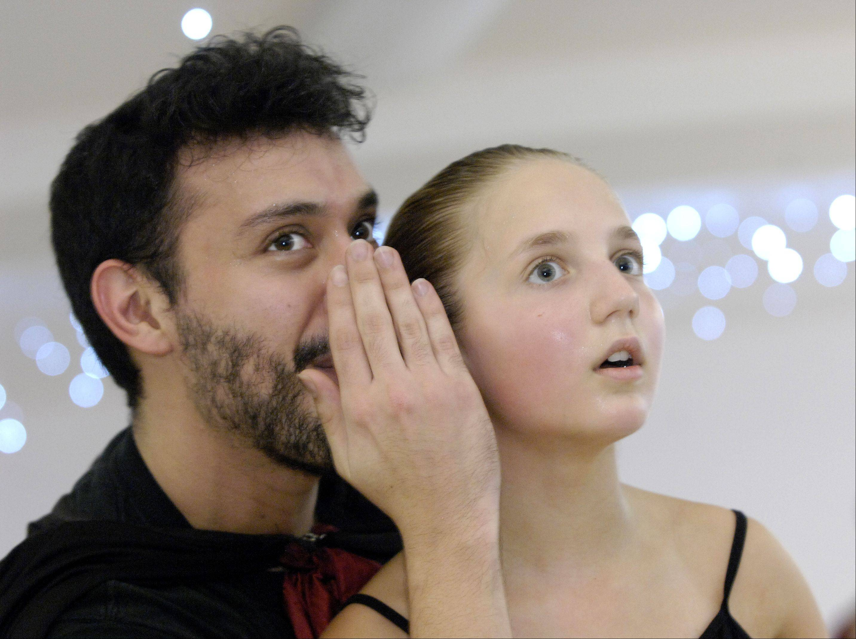 """Herr Drosselmeyer,"" Michael Darnell, whispers in the ear of ""Clara,"" Julia Blahnik, during a rehearsal for ""The Nutcracker."" Two different dancers will portray Clara during the run of the production."