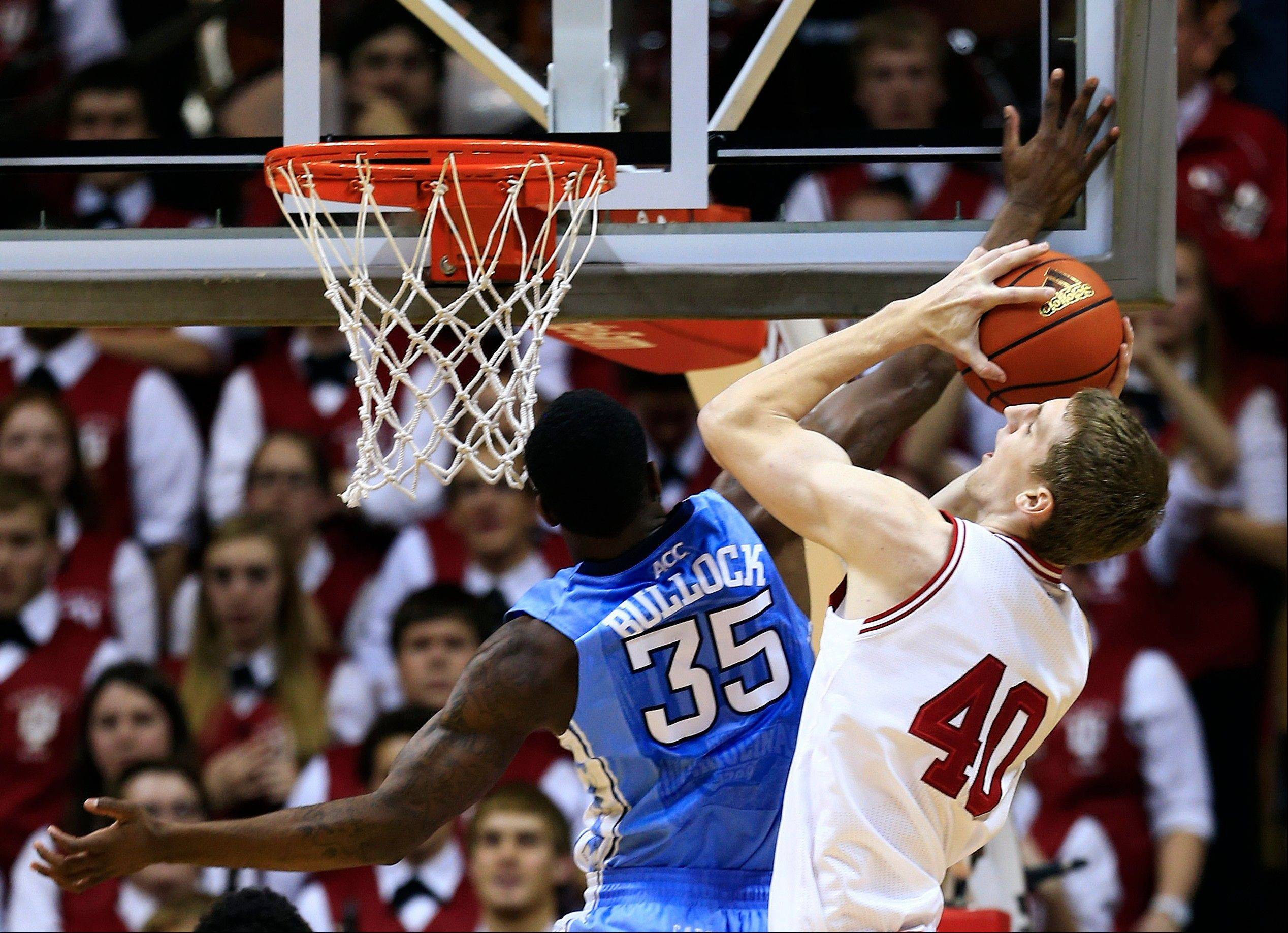 Indiana's Cody Zeller is fouled by North Carolina's Reggie Bullock as he goes up for a shot Tuesday during the first half in Bloomington, Ind.