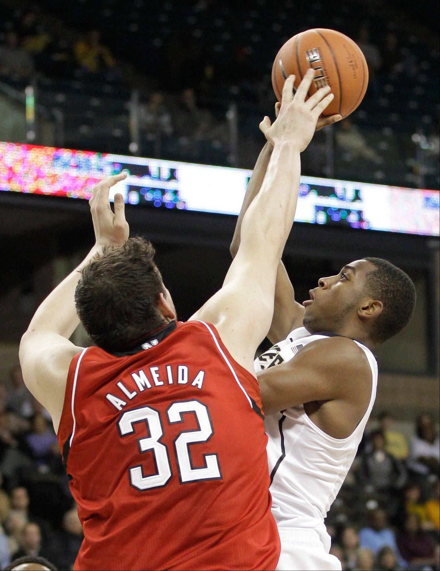 Nebraska's Andre Almeida blocks a shot by Wake Forest's Codi Miller-McIntyre Tuesday during the first half in Winston-Salem, N.C.