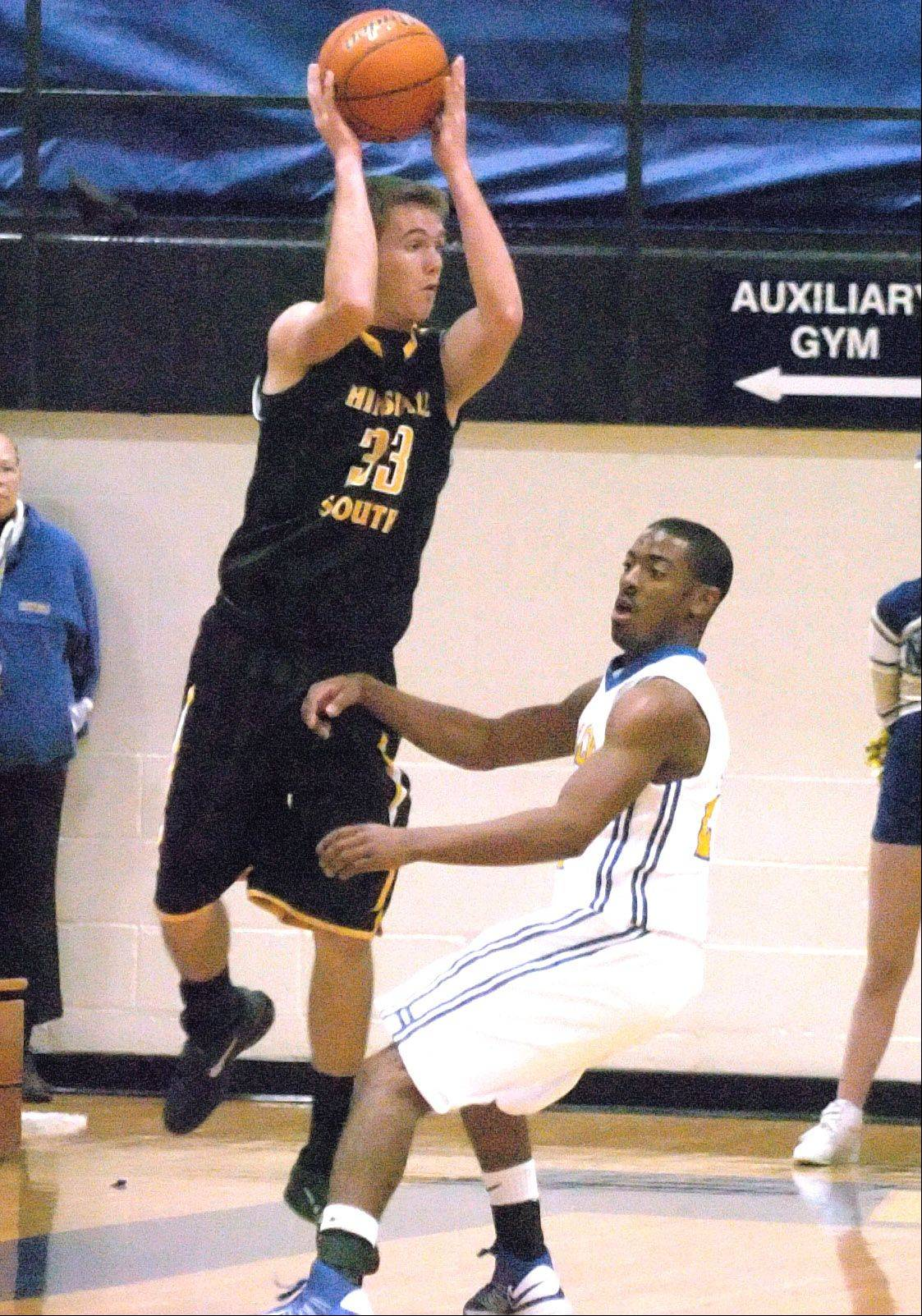 Justin Ward of Hinsdale South looks to pass over Jaylen Howze of Wheaton North.