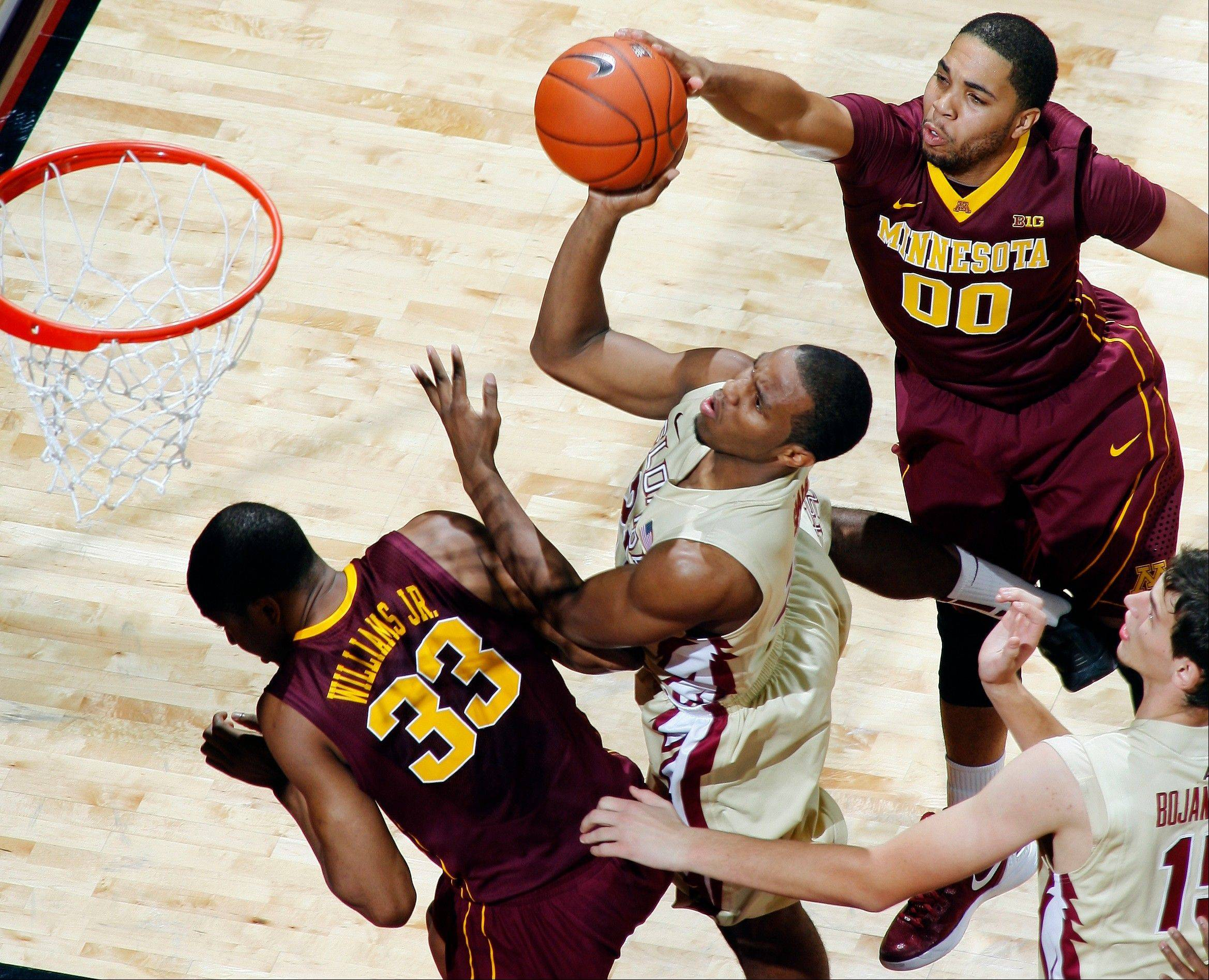 Minnesota forward Rodney Williams Jr., (33) fouls Florida State guard Michael Snaer (21) on a layup as Minnesota guard Julian Welch (00) tries to block the shot Tuesday during the first half in Tallahassee, Fla.